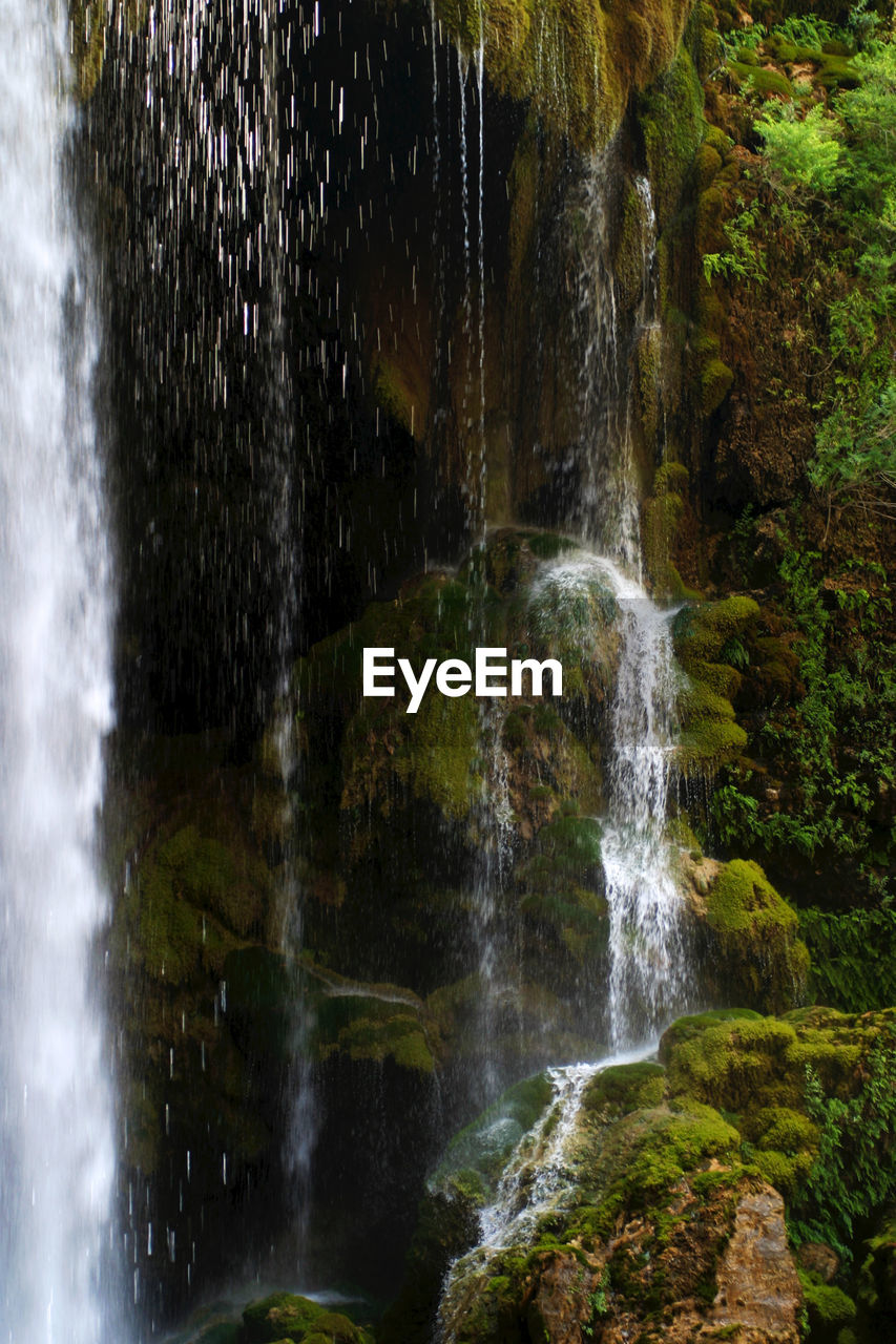 water, motion, scenics - nature, forest, waterfall, beauty in nature, blurred motion, land, long exposure, tree, nature, no people, flowing water, rock, plant, outdoors, rock - object, moss, solid, flowing, rainforest, falling water, purity, power in nature