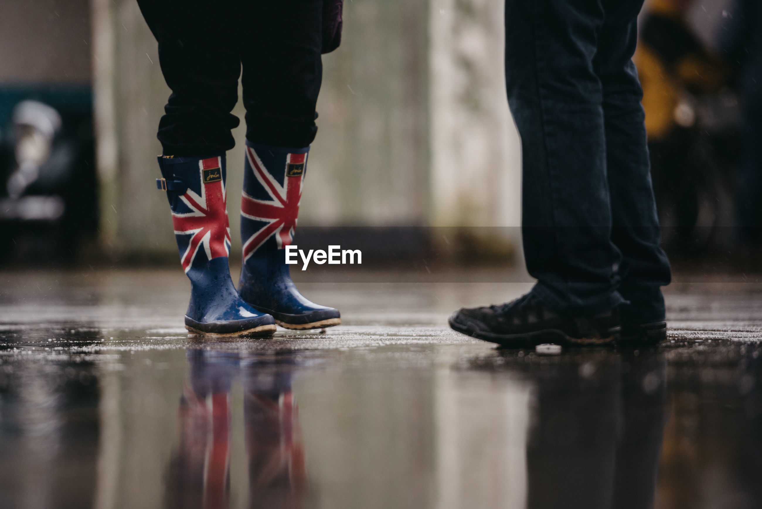 Low section of people wearing designed footwear