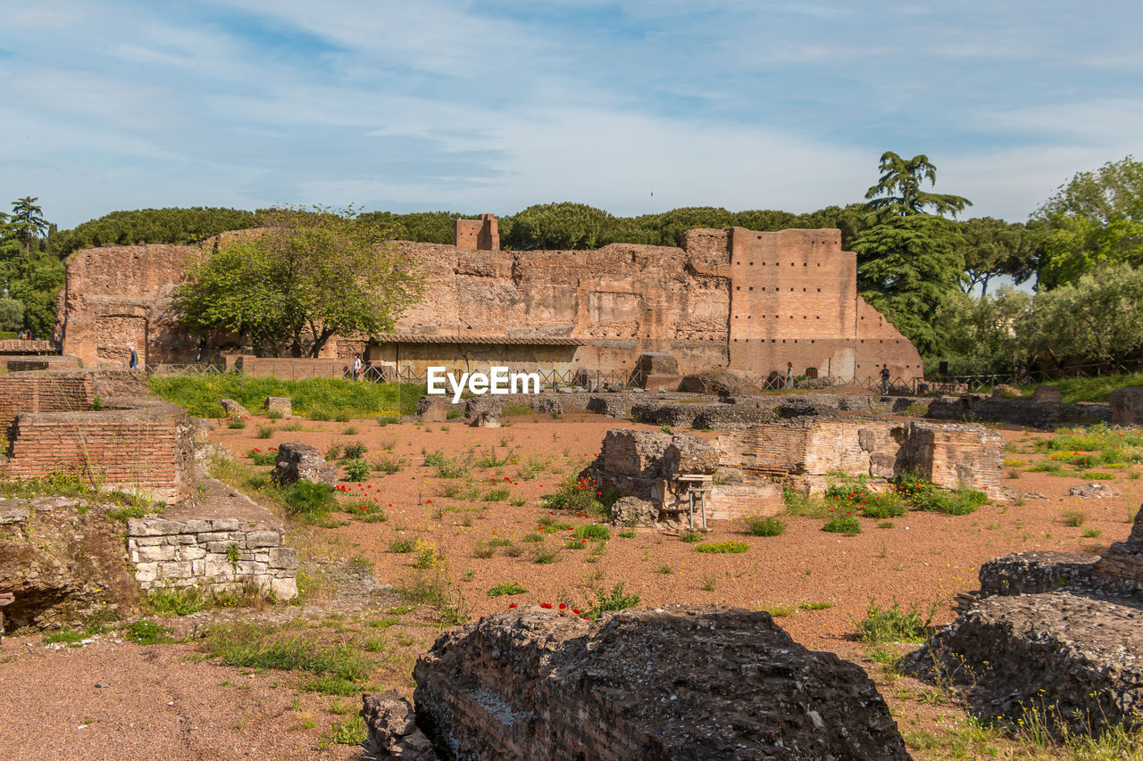 sky, history, architecture, the past, built structure, tree, ancient, nature, plant, old ruin, cloud - sky, old, no people, building exterior, day, solid, travel destinations, ancient civilization, damaged, ruined, outdoors, deterioration, ancient history, archaeology