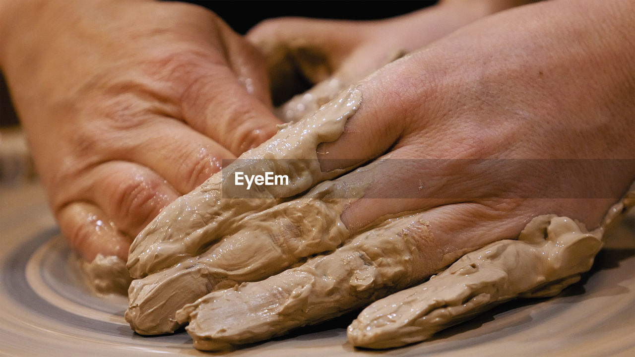 human hand, hand, human body part, real people, one person, unrecognizable person, food and drink, indoors, close-up, preparation, body part, food, focus on foreground, finger, human finger, dough, freshness, lifestyles, holding, preparing food, kneading, human limb