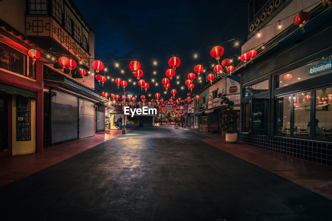 illuminated, architecture, built structure, night, lighting equipment, building exterior, city, red, no people, street, transportation, direction, outdoors, building, sign, communication, the way forward, store, decoration, chinese lantern