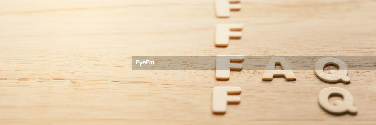 TEXT ON WOODEN TABLE