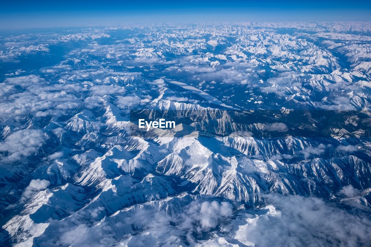 scenics - nature, aerial view, beauty in nature, environment, nature, no people, sky, cloud - sky, snow, mountain, landscape, tranquil scene, cold temperature, winter, mountain range, day, physical geography, tranquility, outdoors, snowcapped mountain, view into land