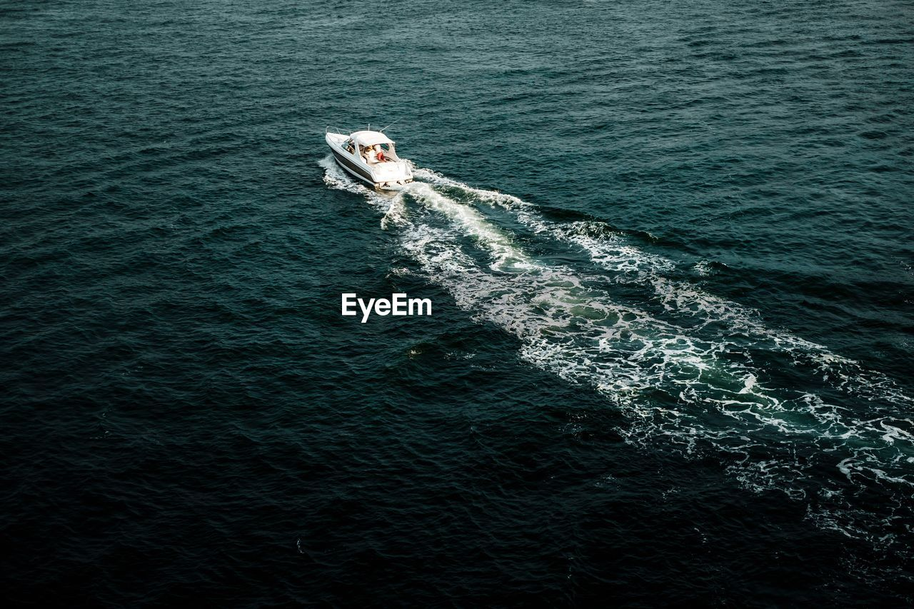 High angle view of motorboat sailing in sea