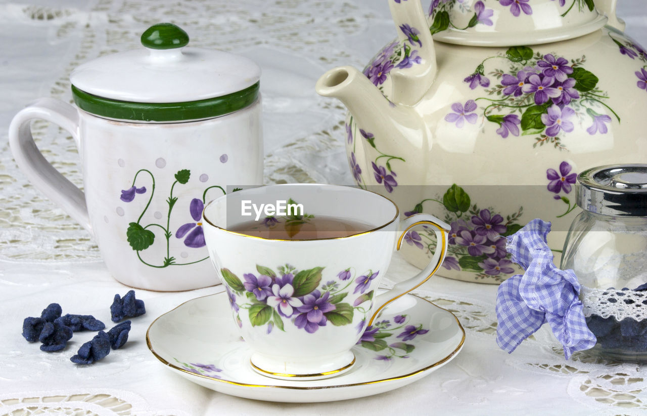 Elegant Tea Cup With Purple Floral Pattern