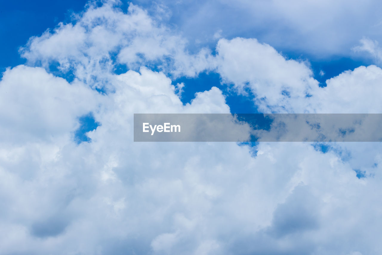 cloud - sky, sky, beauty in nature, low angle view, blue, white color, no people, scenics - nature, tranquility, day, nature, outdoors, backgrounds, full frame, tranquil scene, non-urban scene, idyllic, cloudscape, softness, meteorology