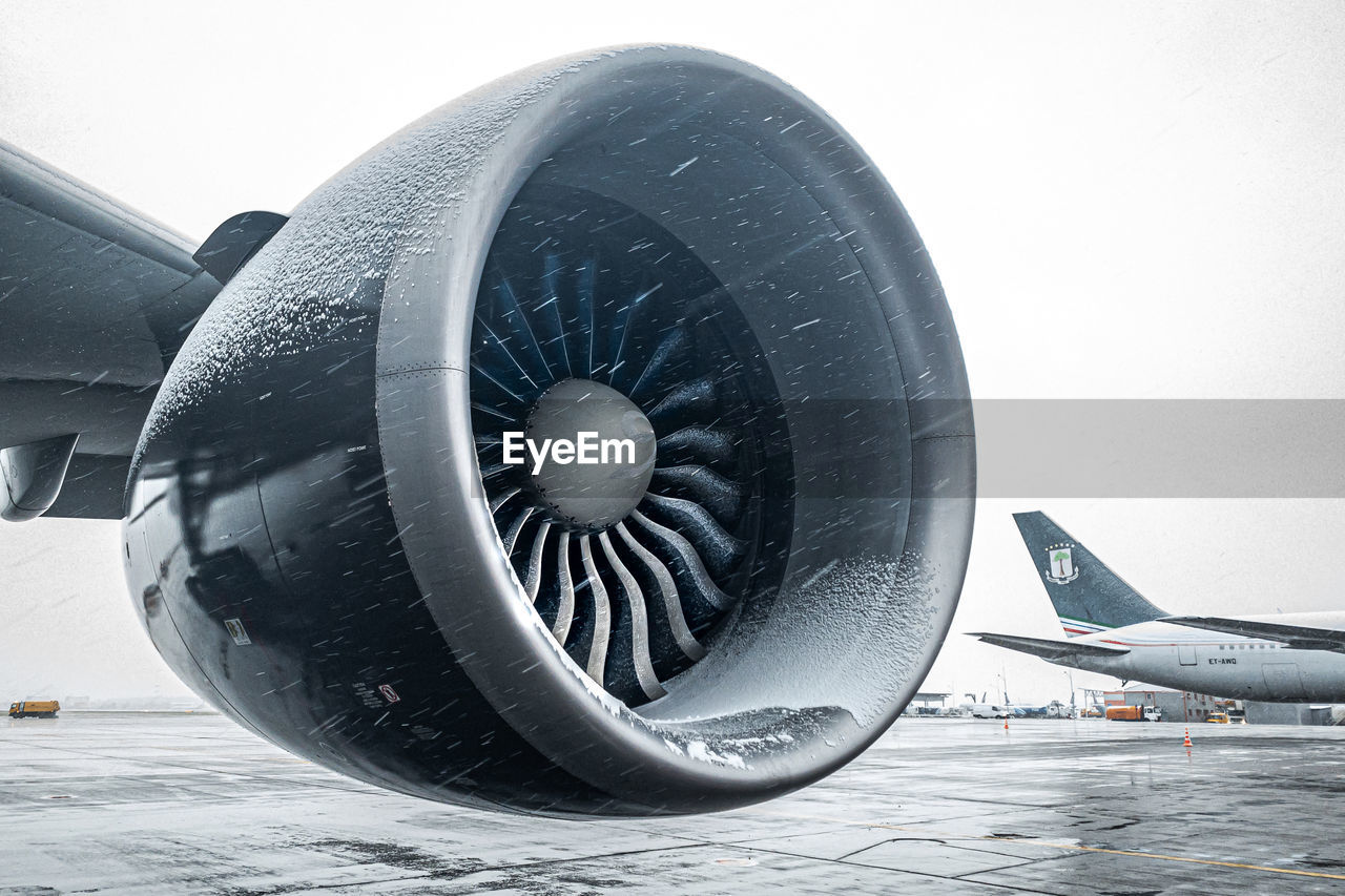 air vehicle, airplane, transportation, mode of transportation, no people, nature, sky, day, jet engine, winter, engine, cold temperature, travel, water, close-up, clear sky, outdoors, snow, aerospace industry