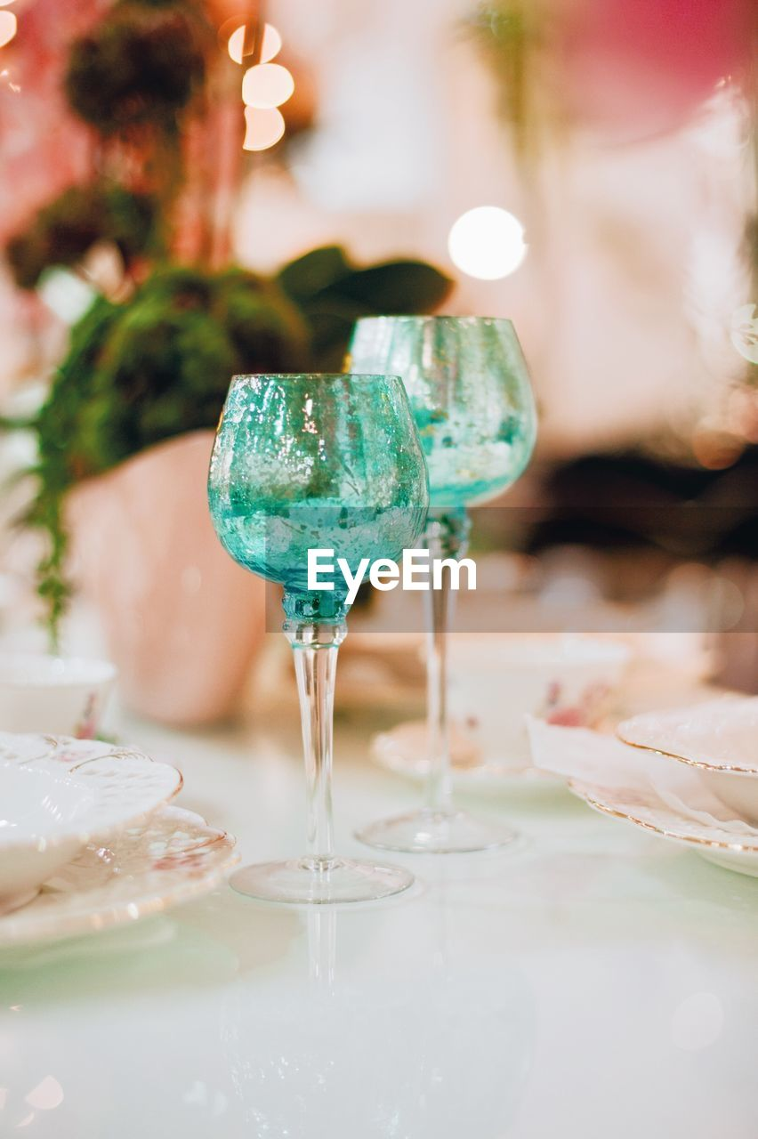 food and drink, wineglass, glass, refreshment, drink, table, indoors, celebration, close-up, food, selective focus, alcohol, freshness, wine, no people, plate, still life, glass - material, focus on foreground, luxury, temptation