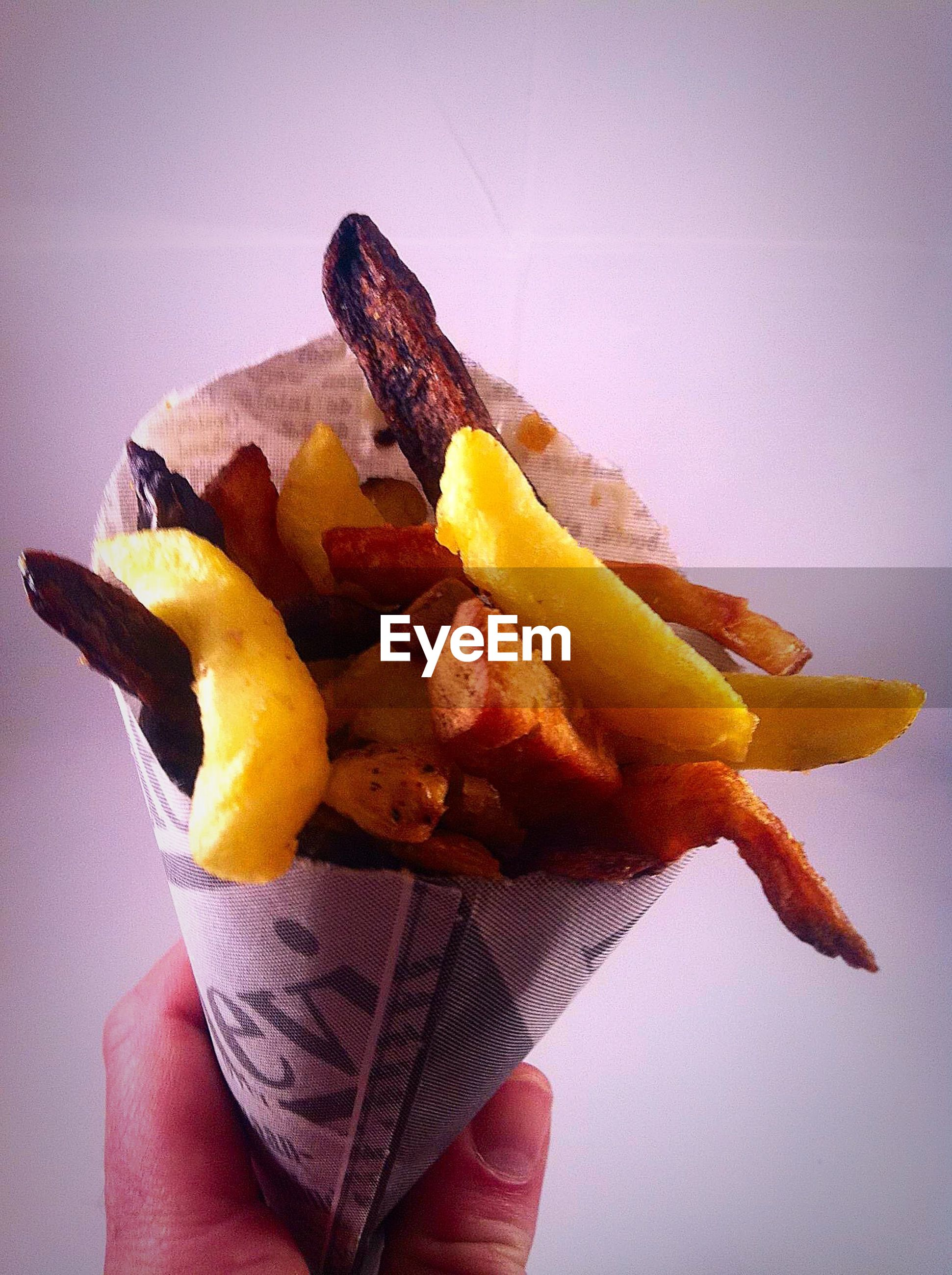 food and drink, food, holding, freshness, person, healthy eating, fruit, cropped, part of, yellow, close-up, banana, human finger, unrecognizable person, slice, ready-to-eat, indoors