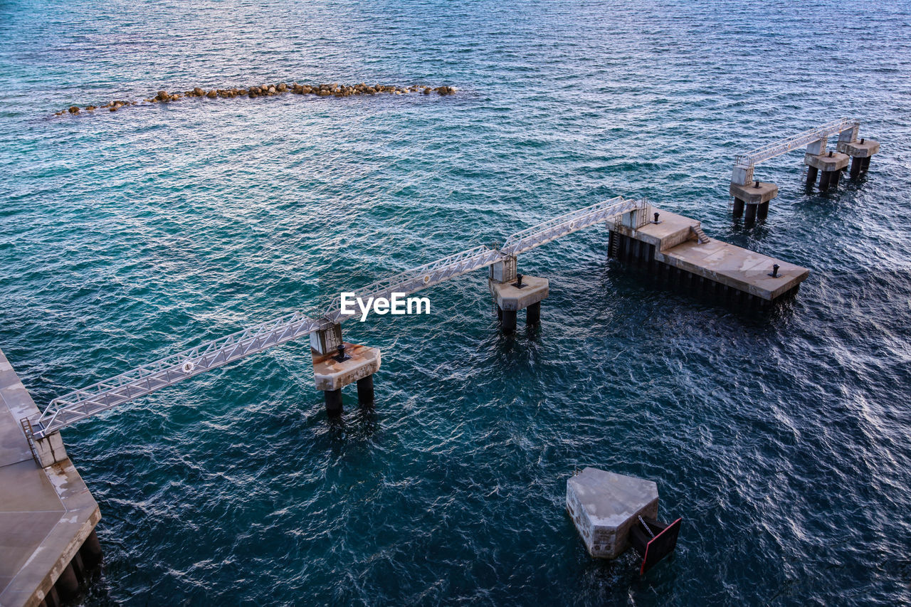 High Angle View Of Incomplete Pier Over Sea