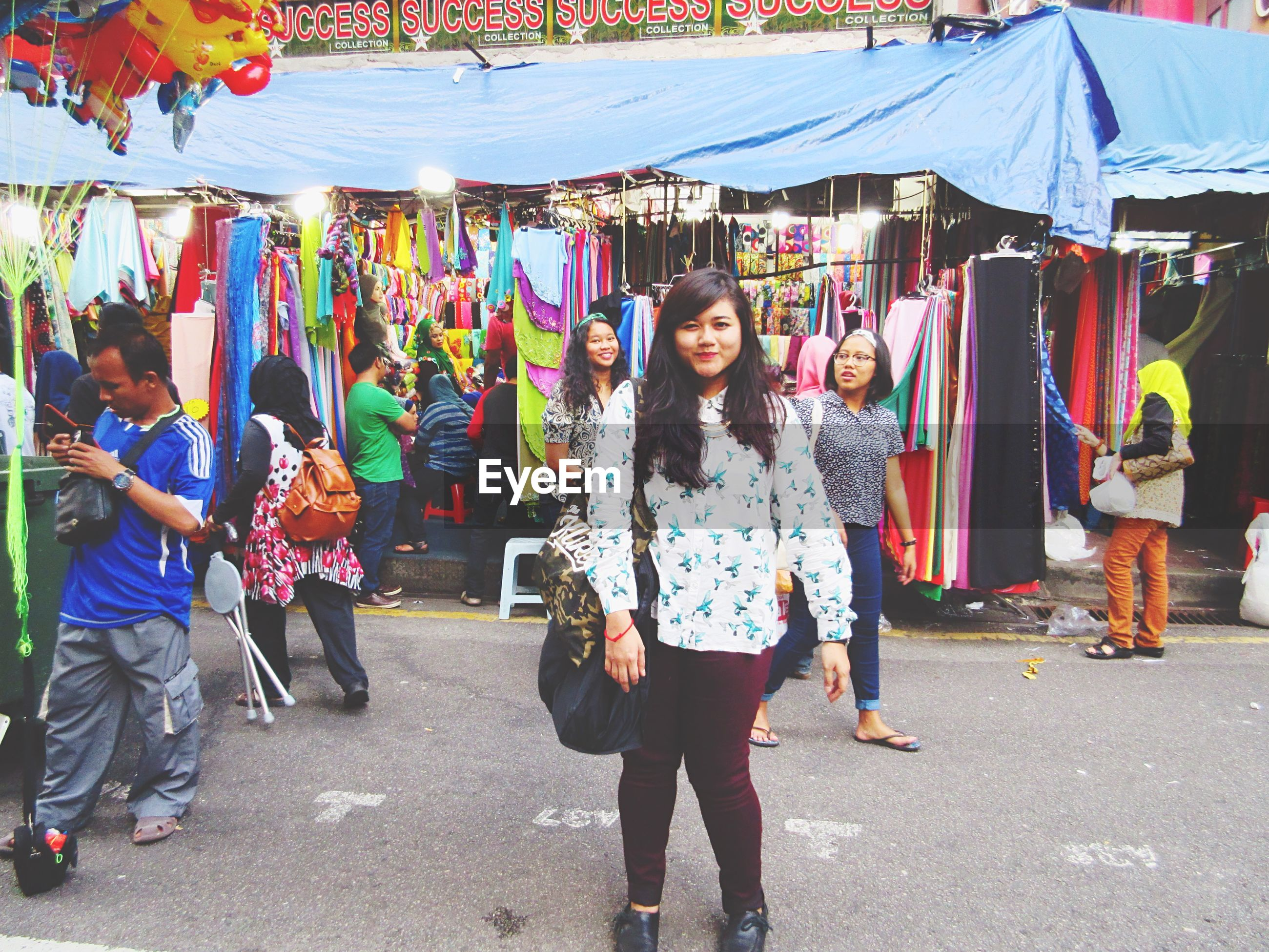 lifestyles, leisure activity, casual clothing, large group of people, person, traditional clothing, men, full length, standing, street, cultures, tradition, walking, market, happiness, market stall, celebration, togetherness, traditional festival