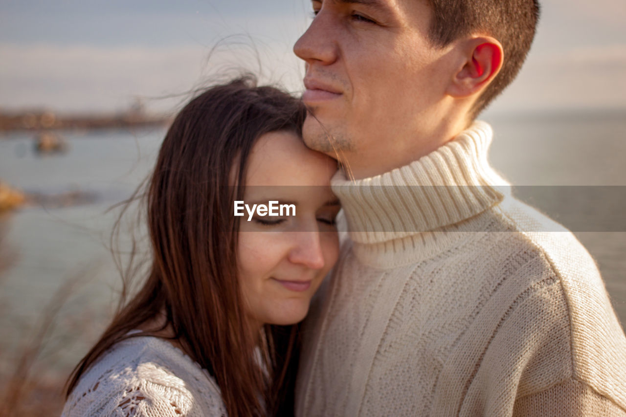 two people, headshot, love, portrait, togetherness, women, emotion, adult, young women, water, positive emotion, young adult, bonding, leisure activity, men, people, casual clothing, focus on foreground, hair, hairstyle, couple - relationship, beautiful woman, outdoors