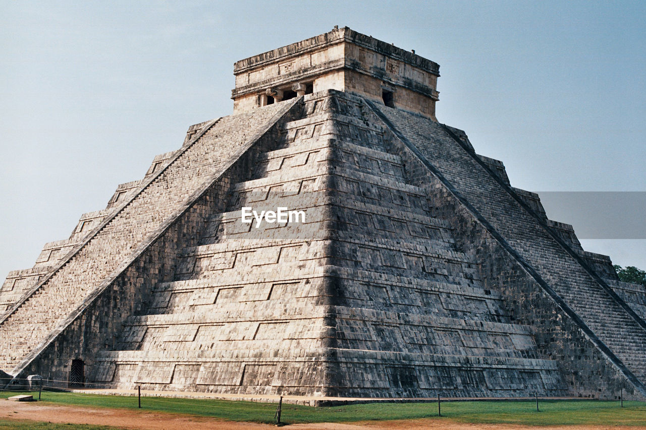architecture, history, built structure, the past, sky, building exterior, travel destinations, ancient, nature, tourism, travel, low angle view, day, pyramid, ancient civilization, grass, no people, outdoors, place of worship, archaeology