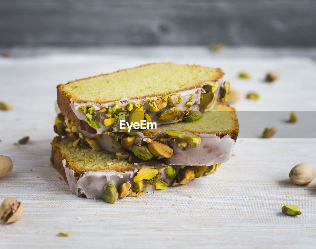 Close-Up Of Avocado Cake With Pistachio On Table