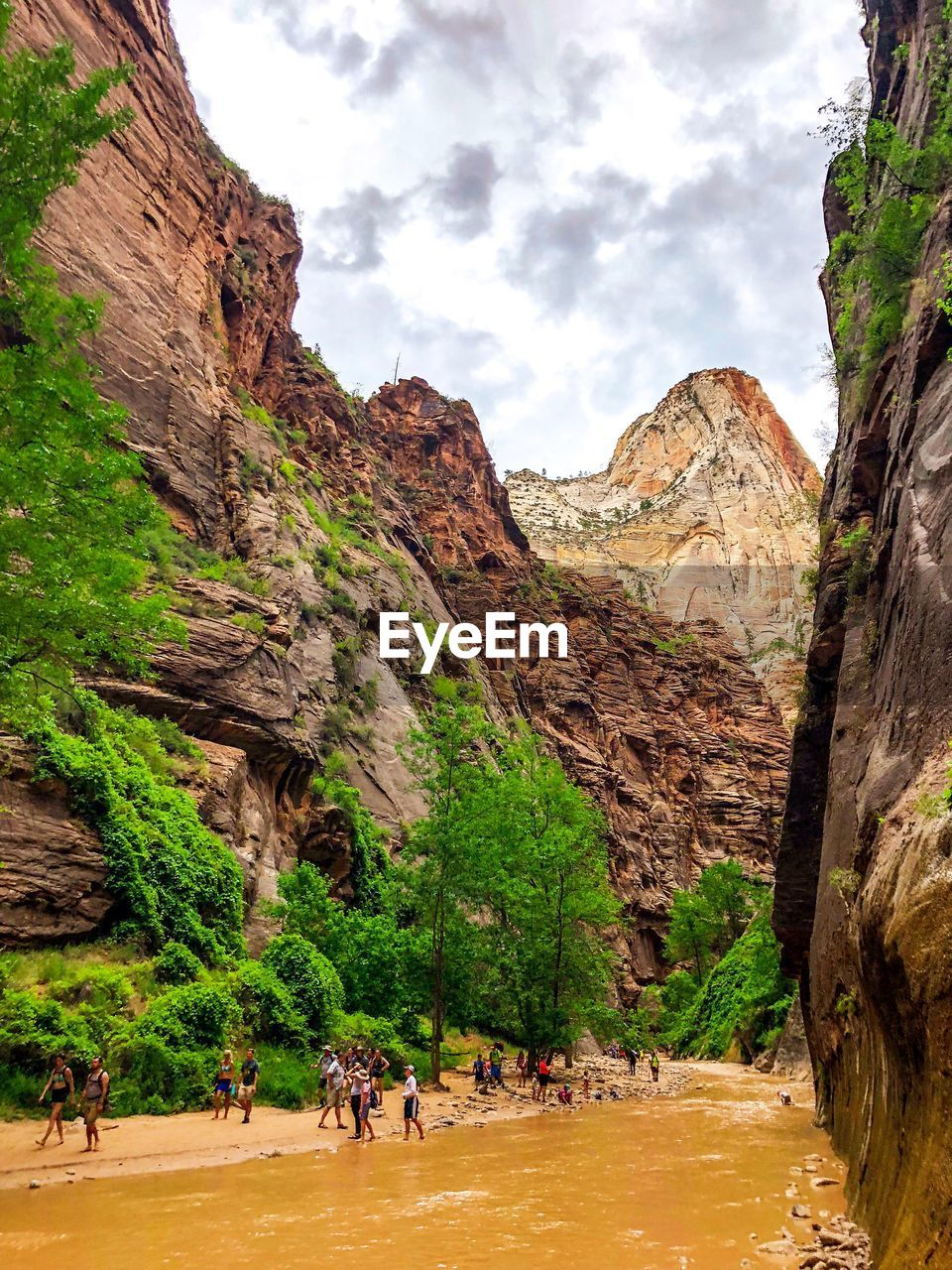 group of people, mountain, rock formation, real people, nature, rock, plant, day, sky, beauty in nature, scenics - nature, tree, land, cloud - sky, solid, men, leisure activity, rock - object, travel destinations, large group of people, mountain range, formation, outdoors