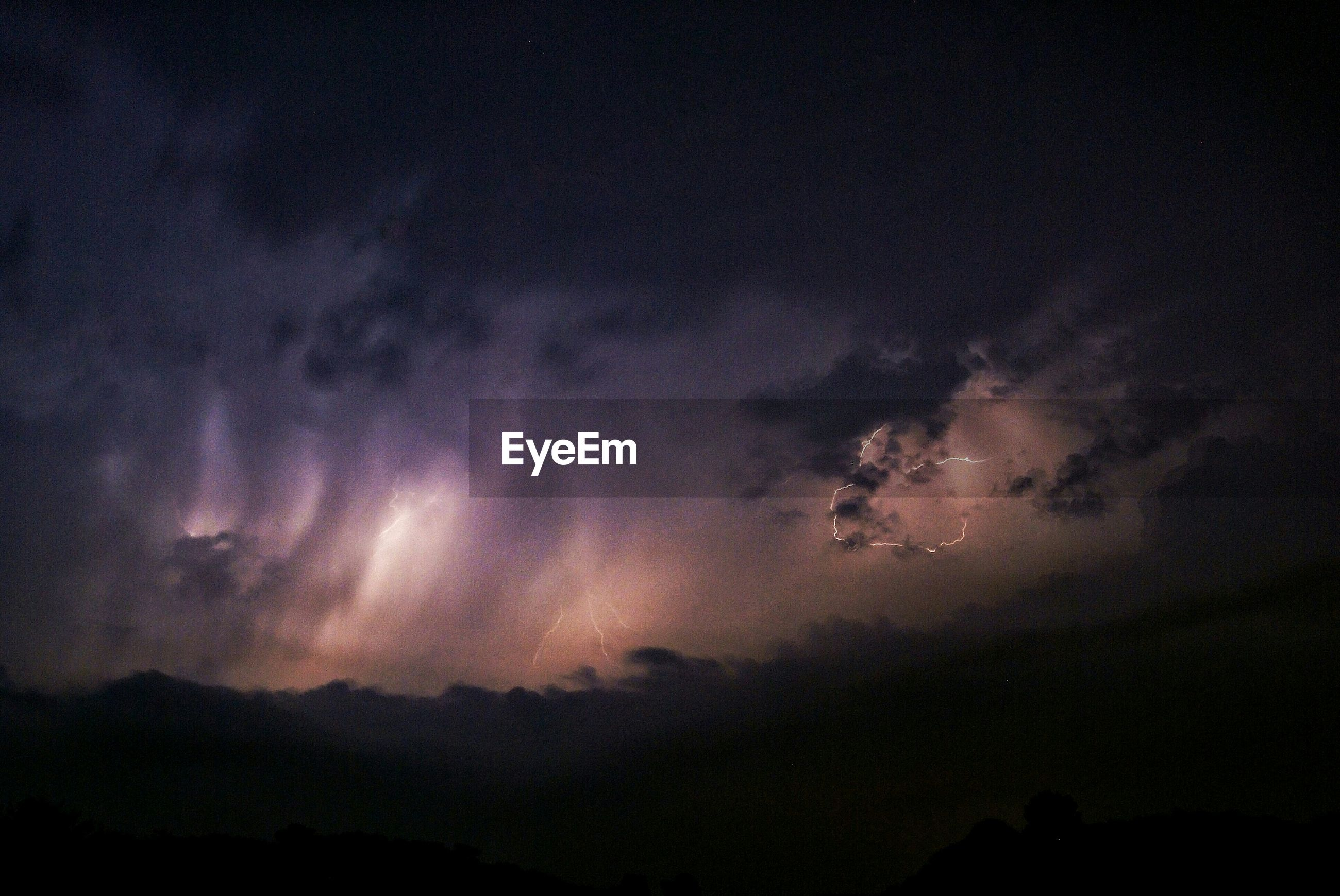 Scenic view of cloudy sky at night