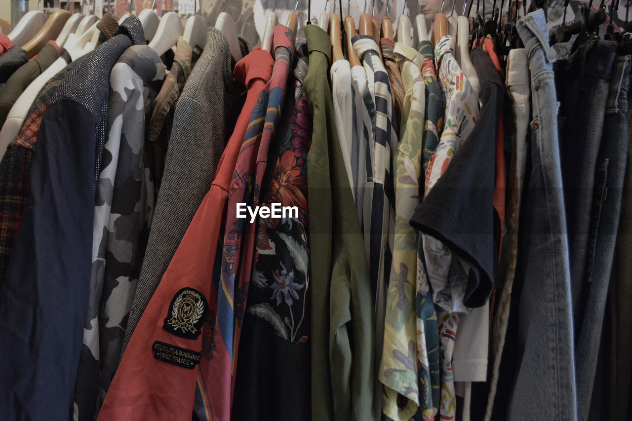 CLOSE-UP OF CLOTHES HANGING ON STORE