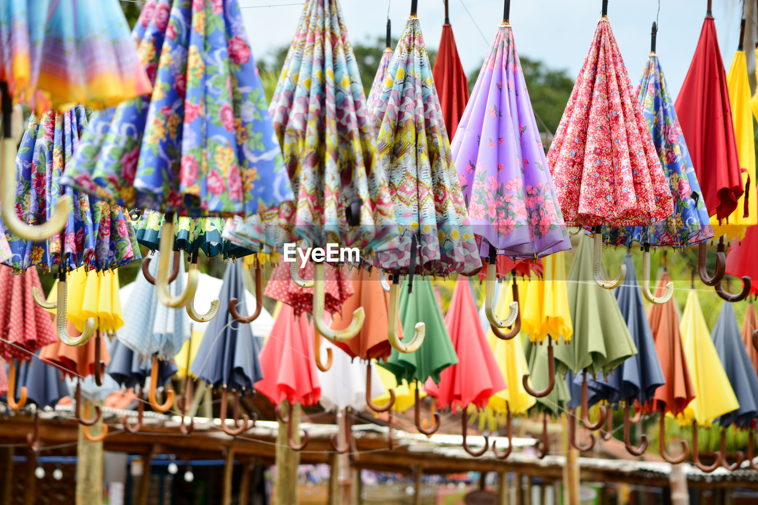 Multi colored umbrellas hanging at market stall