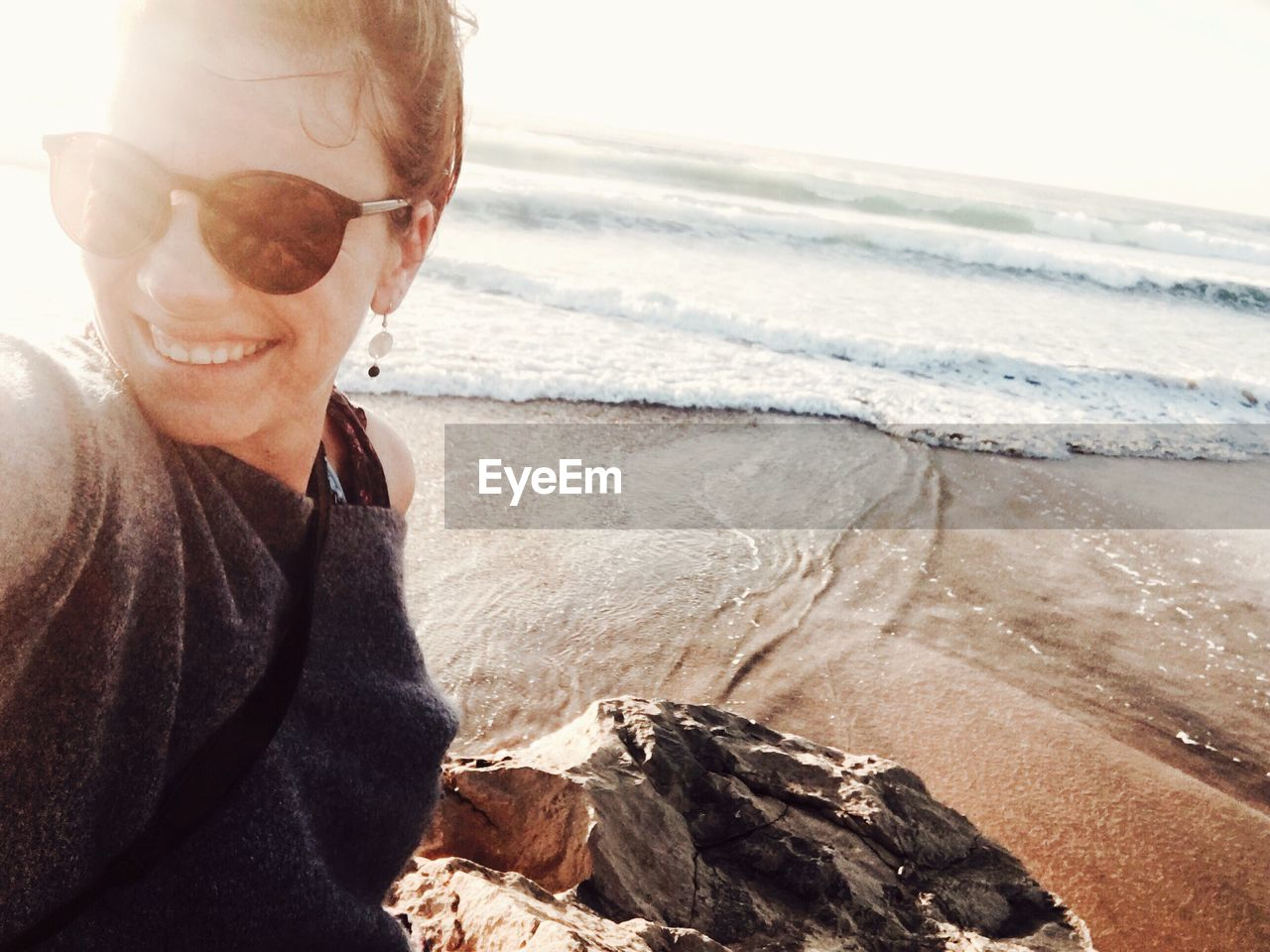 Happy woman on shore at beach