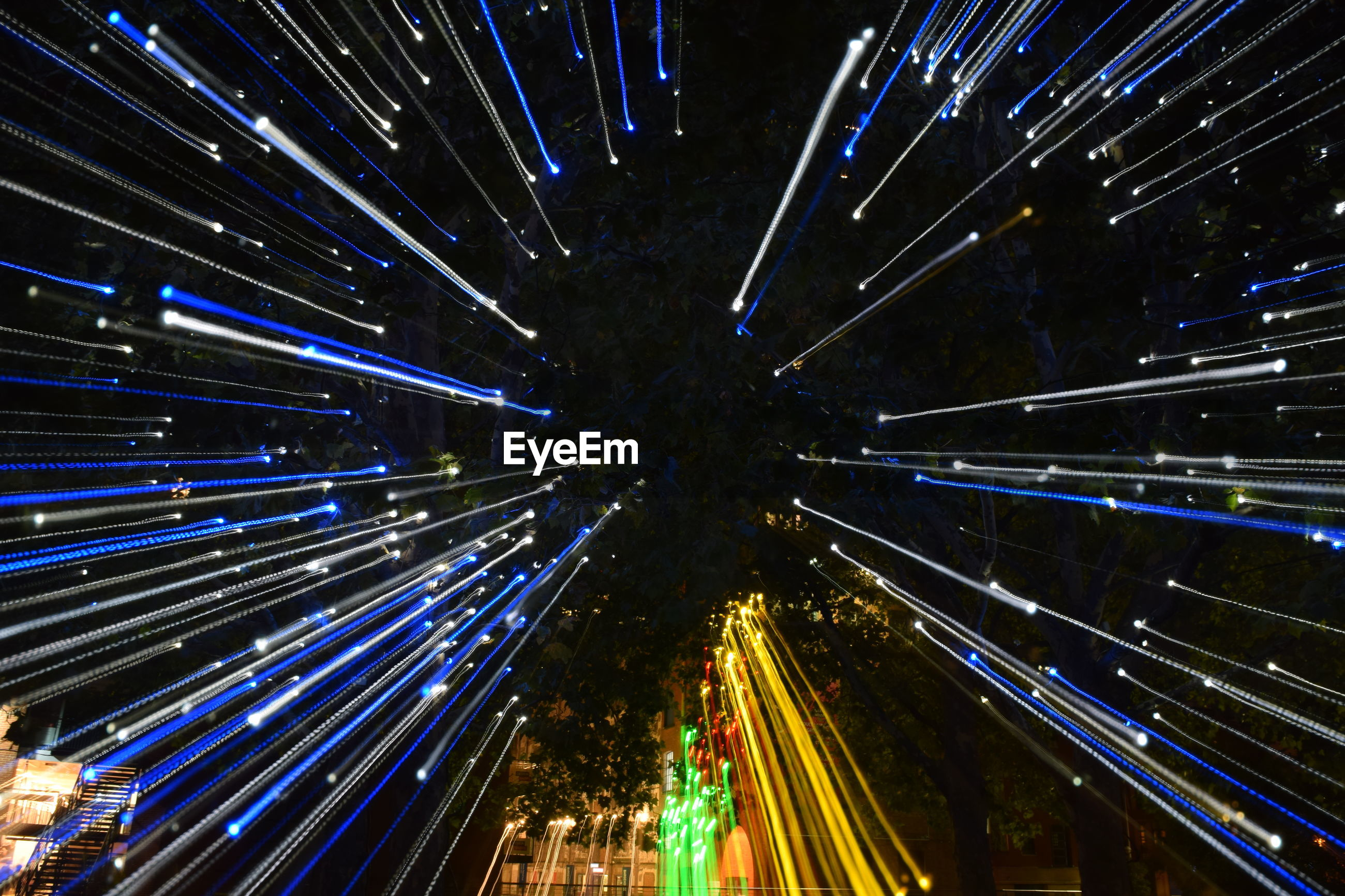 HIGH ANGLE VIEW OF LIGHT TRAILS IN CITY