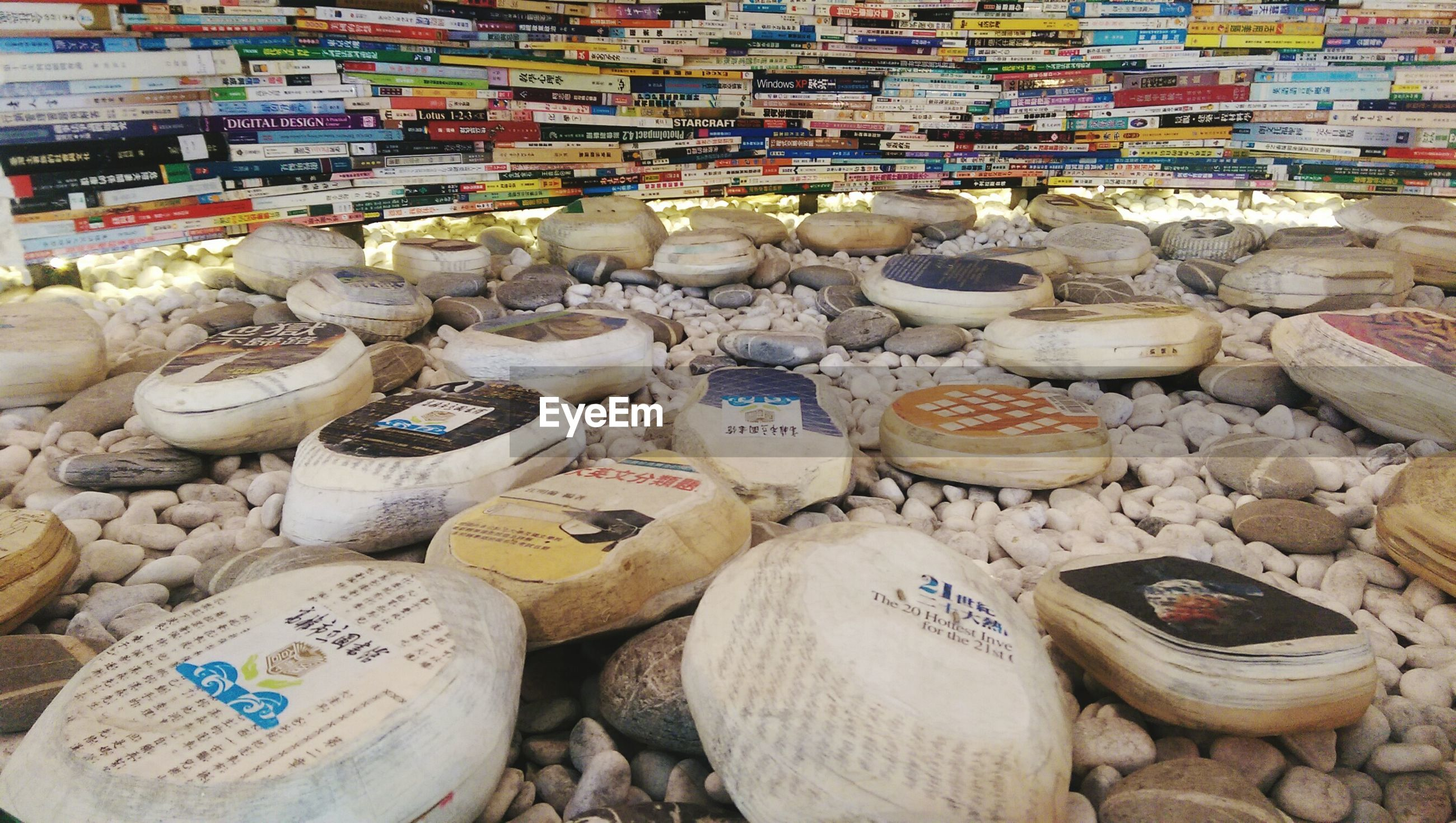 Pebble stones against book stack in kaohsiung public library