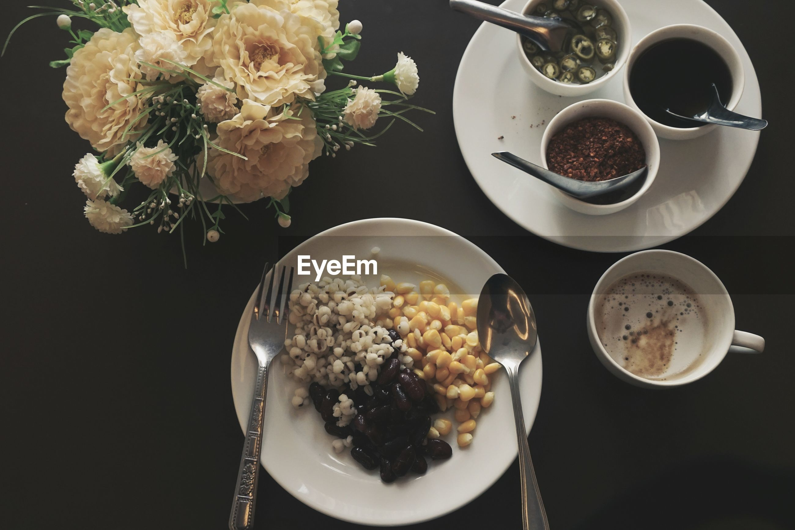 High angle view of breakfast in plates on table