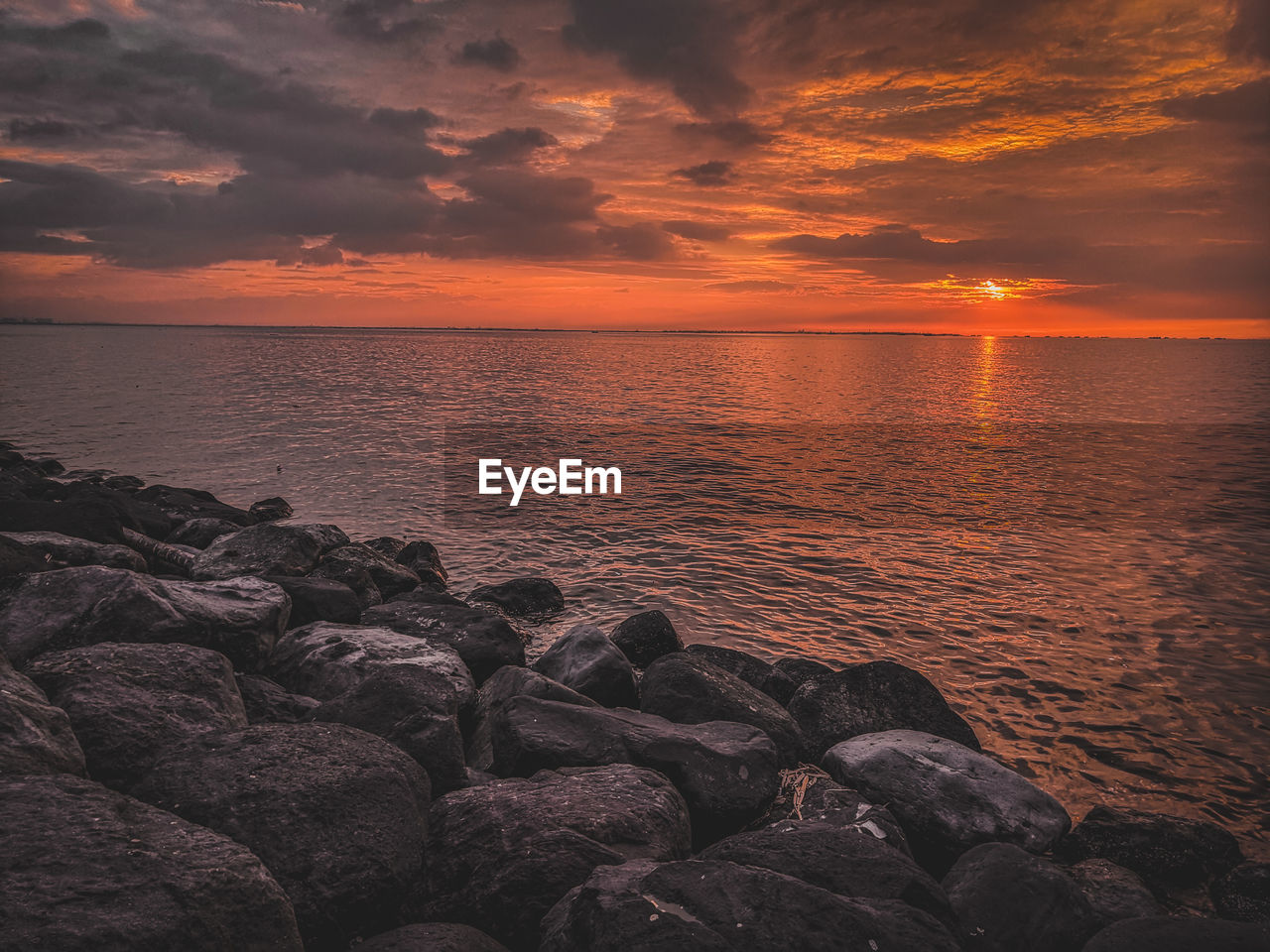 sky, sea, water, sunset, beauty in nature, scenics - nature, rock, solid, horizon, cloud - sky, horizon over water, rock - object, tranquility, tranquil scene, idyllic, orange color, beach, nature, no people, pebble, rocky coastline