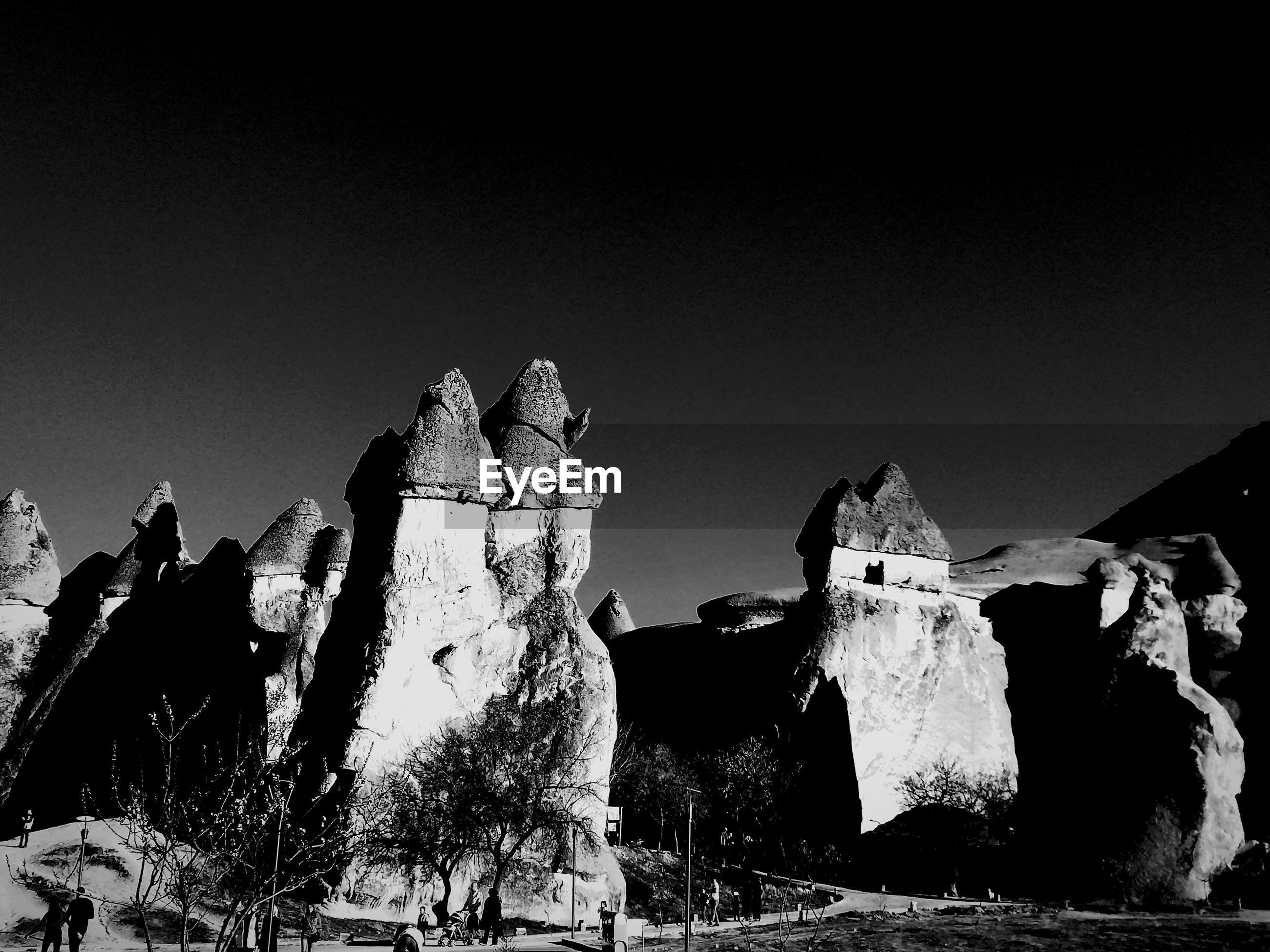 Low angle view of rock formations against clear sky