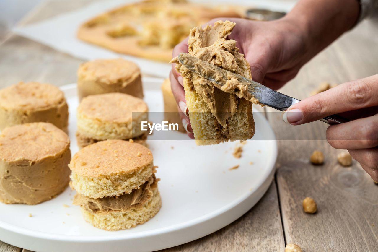 Close-Up Of Woman Preparing Dessert
