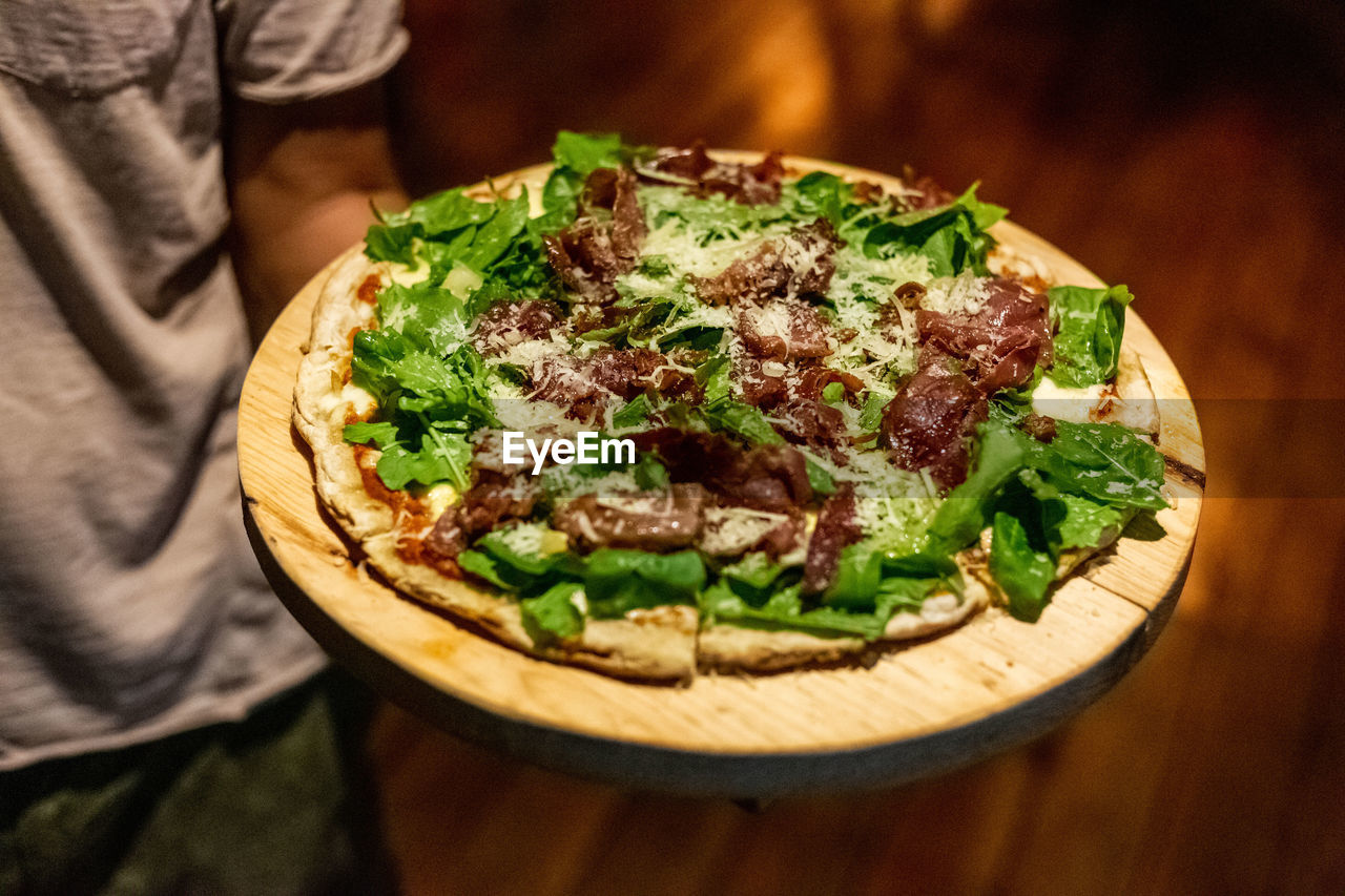 food and drink, food, freshness, ready-to-eat, table, indoors, close-up, high angle view, focus on foreground, still life, pizza, healthy eating, meat, serving size, selective focus, vegetable, no people, wellbeing, garnish, temptation, snack