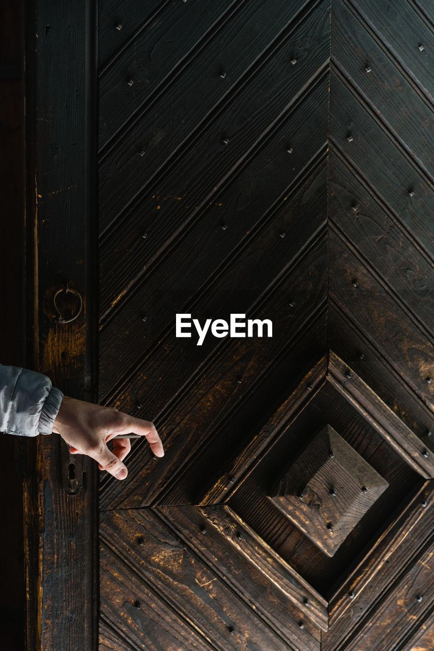 Cropped Hand Holding Door Handle