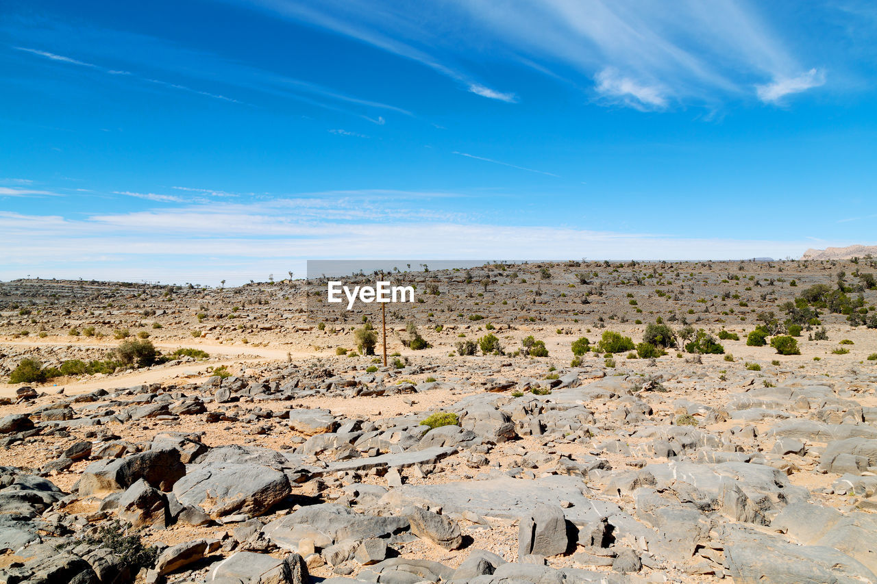 Idyllic Shot Of Desert Landscape Against Blue Sky