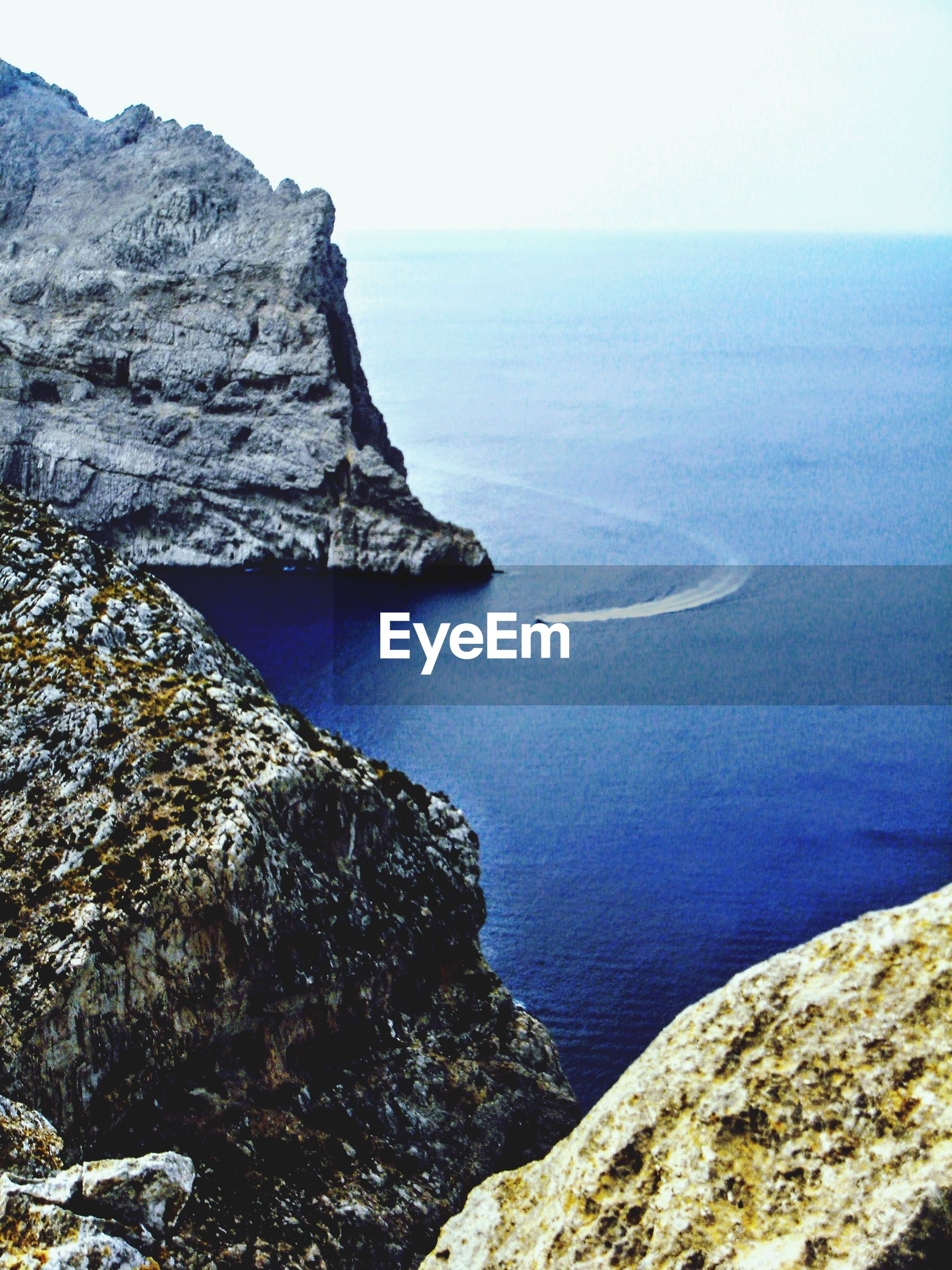 SCENIC VIEW OF BAY AND ROCK FORMATION