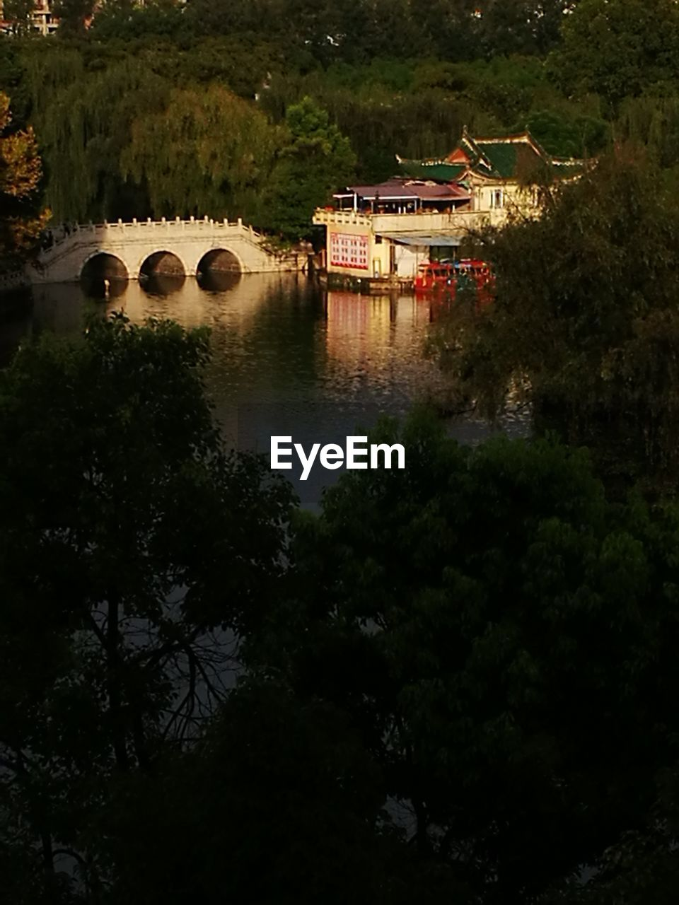 Scenic View Of River By Trees Against Sky