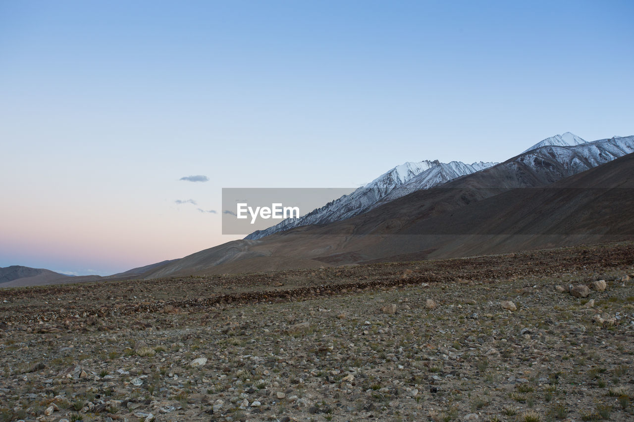 sky, mountain, environment, landscape, beauty in nature, scenics - nature, tranquil scene, tranquility, non-urban scene, nature, copy space, land, no people, mountain range, blue, snow, winter, remote, cold temperature, clear sky, outdoors, snowcapped mountain, mountain peak, arid climate