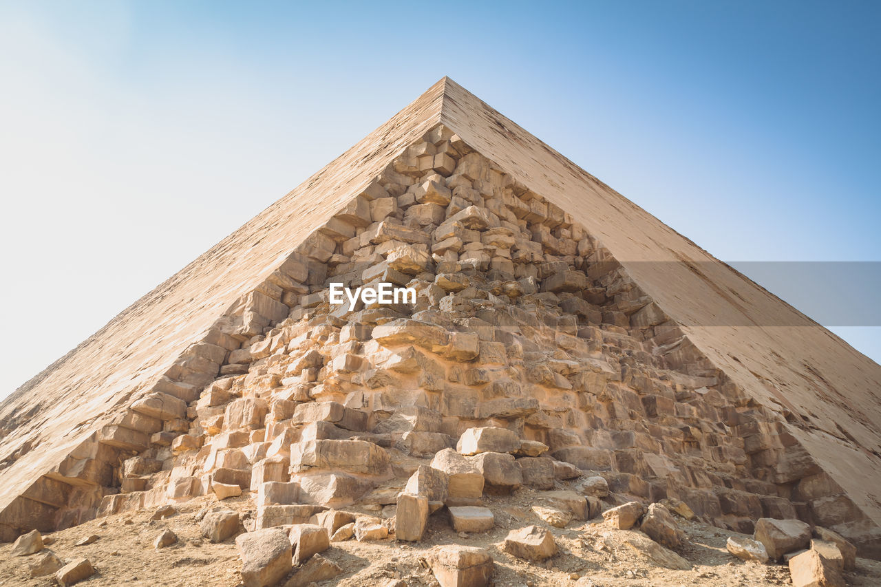 architecture, the past, history, built structure, ancient, ancient civilization, low angle view, travel destinations, sky, nature, travel, no people, solid, pyramid, tourism, day, clear sky, sunlight, building exterior, outdoors, archaeology