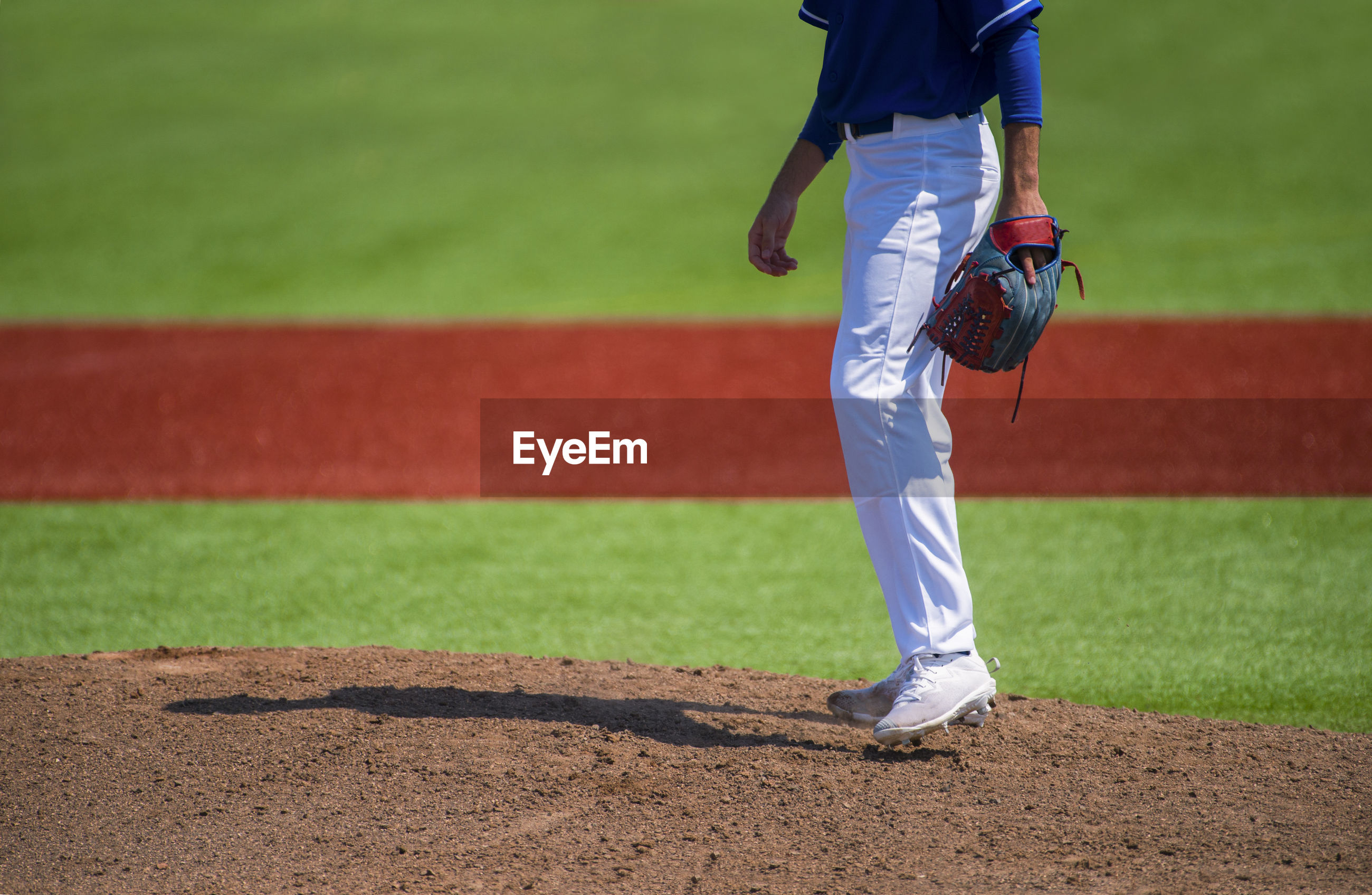 Low section of baseball player standing on playing field