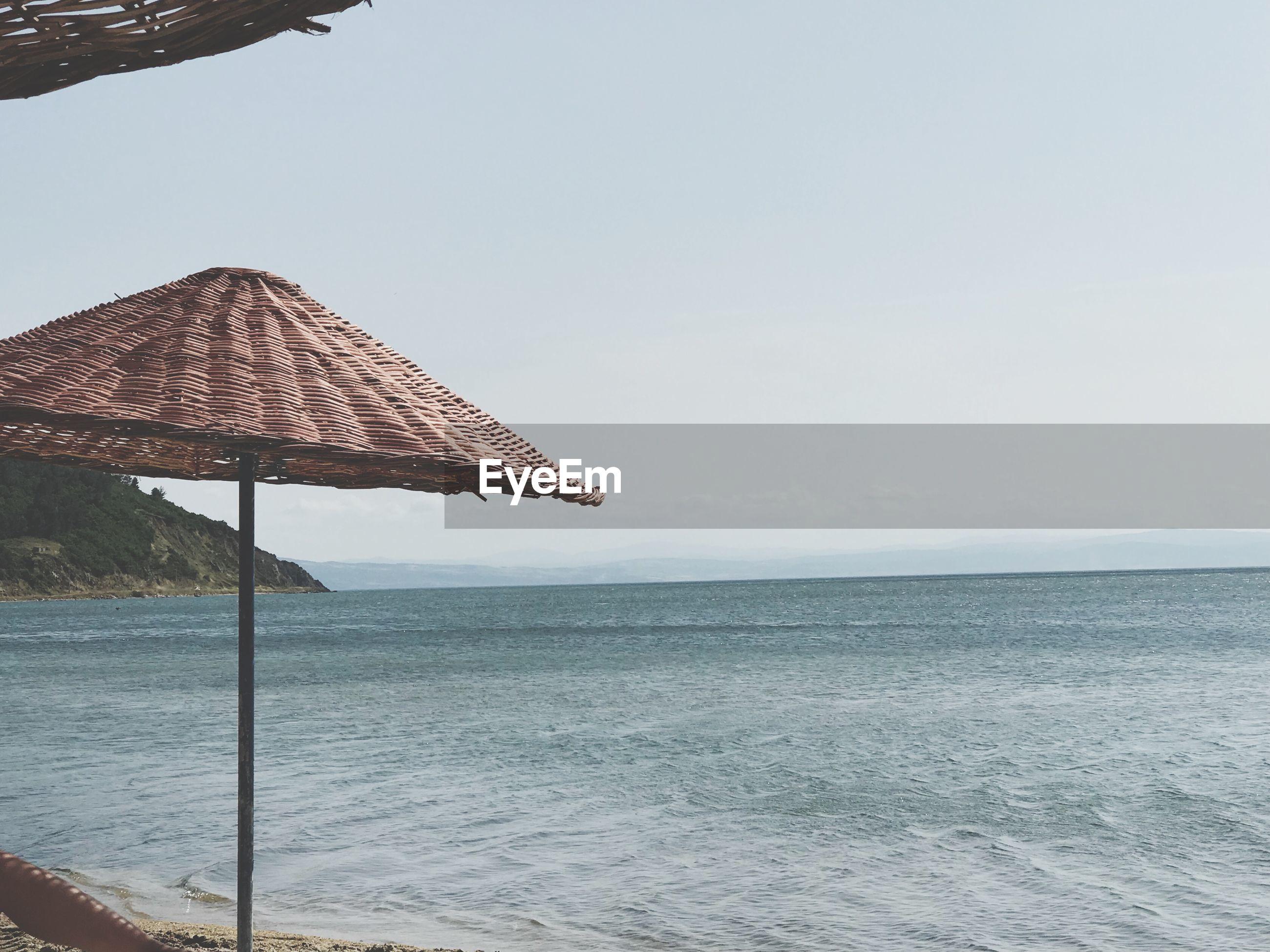 GAZEBO ON BEACH AGAINST CLEAR SKY