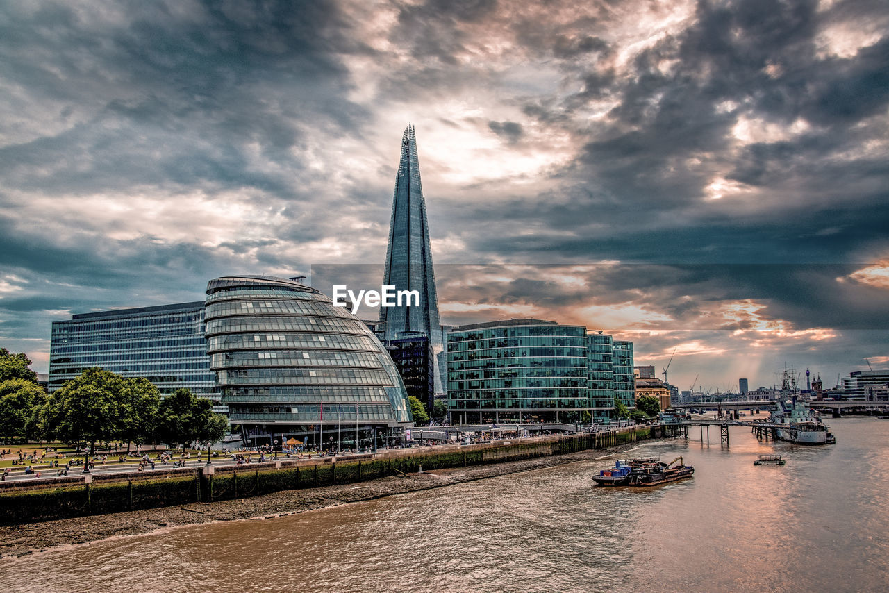 built structure, architecture, sky, building exterior, cloud - sky, city, water, building, office building exterior, transportation, nature, nautical vessel, travel destinations, skyscraper, travel, mode of transportation, incidental people, tall - high, modern, outdoors