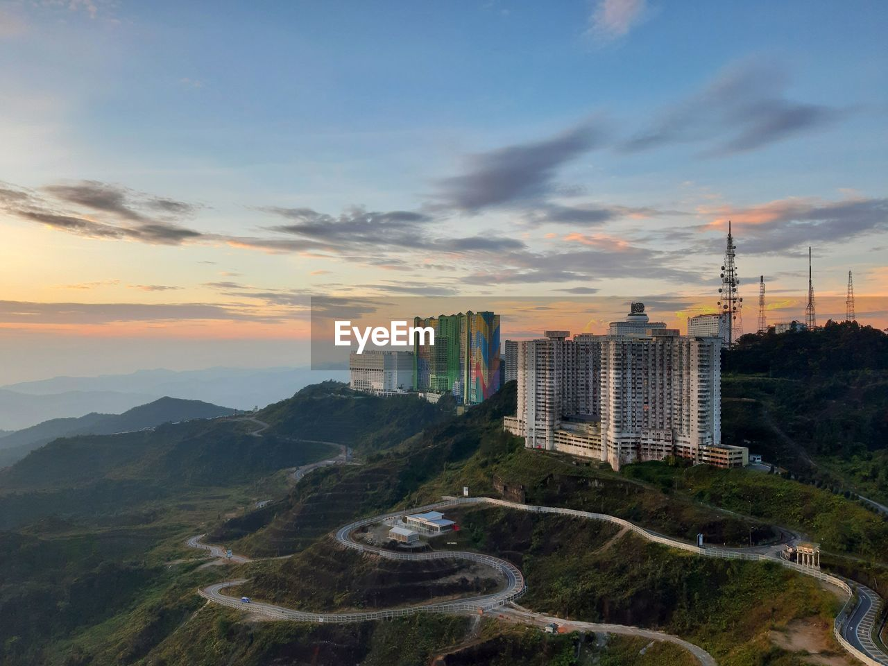 sky, cloud - sky, building exterior, built structure, architecture, city, sunset, building, nature, office building exterior, skyscraper, mountain, no people, landscape, tree, tall - high, modern, high angle view, cityscape, outdoors