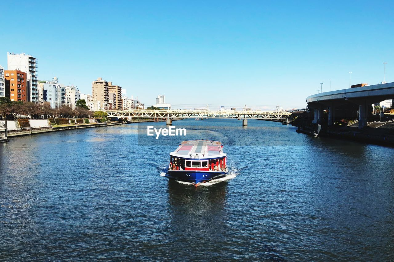 architecture, built structure, transportation, mode of transport, building exterior, nautical vessel, day, clear sky, water, outdoors, waterfront, nature, city, no people, sky