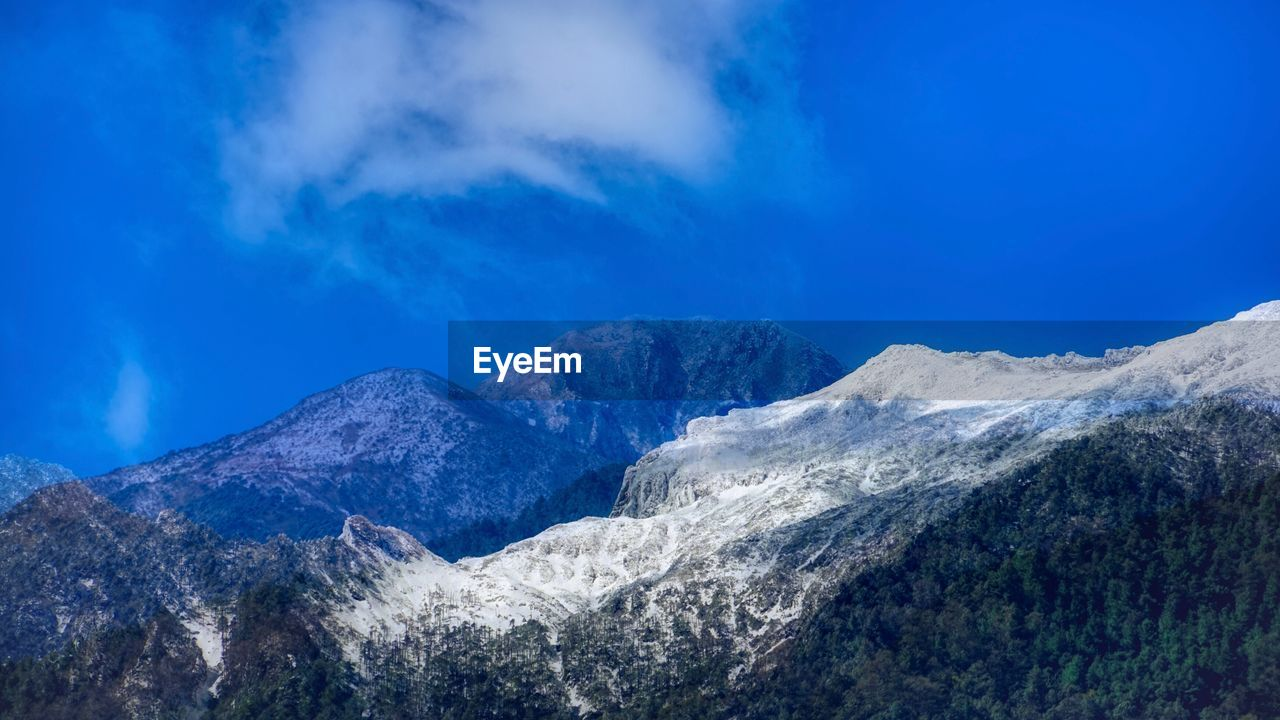 mountain, scenics - nature, sky, beauty in nature, tranquil scene, mountain range, cloud - sky, tranquility, environment, cold temperature, winter, non-urban scene, snow, nature, blue, no people, idyllic, day, landscape, snowcapped mountain, outdoors, mountain peak