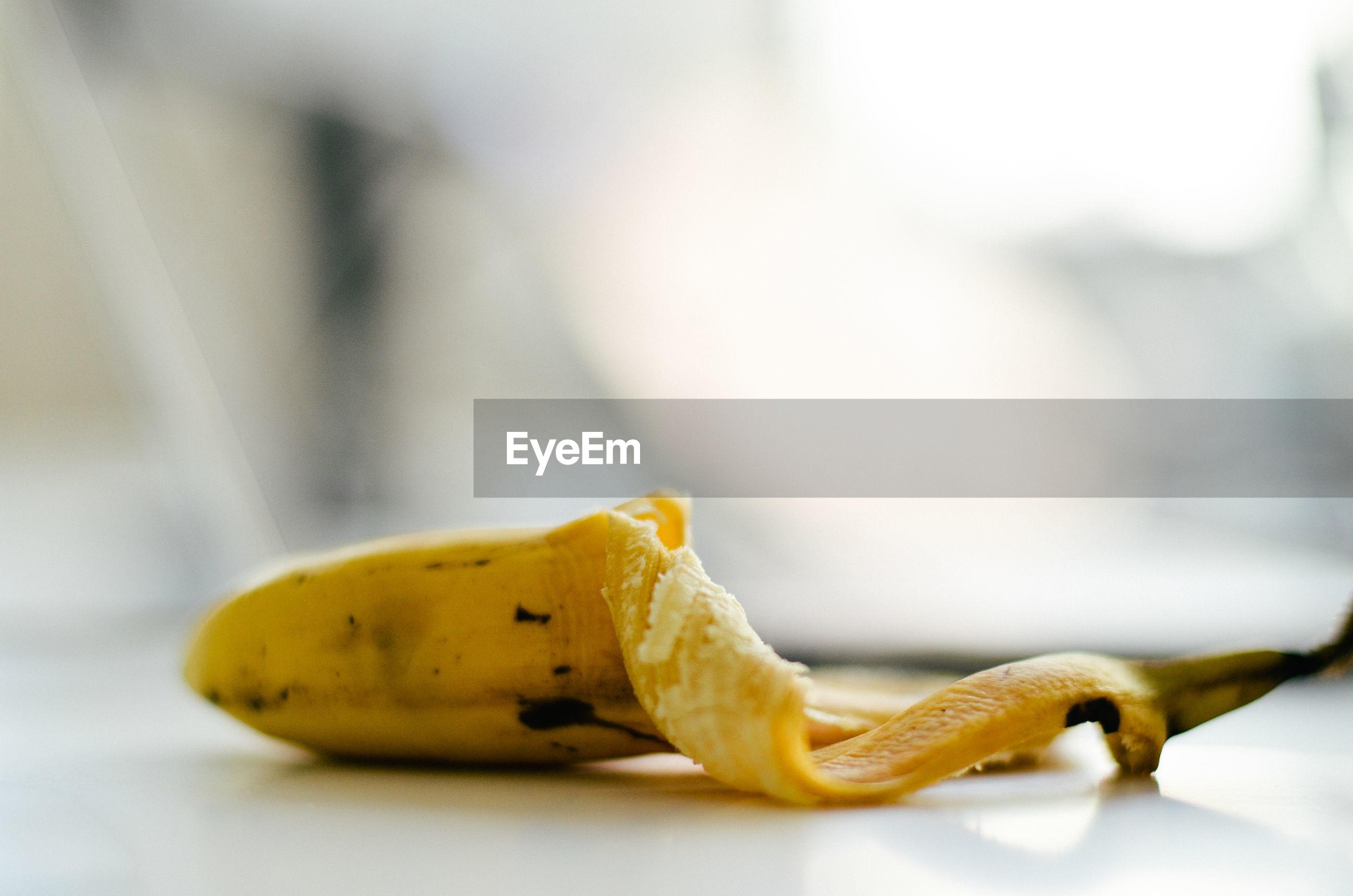 Close-up of banana peel at table