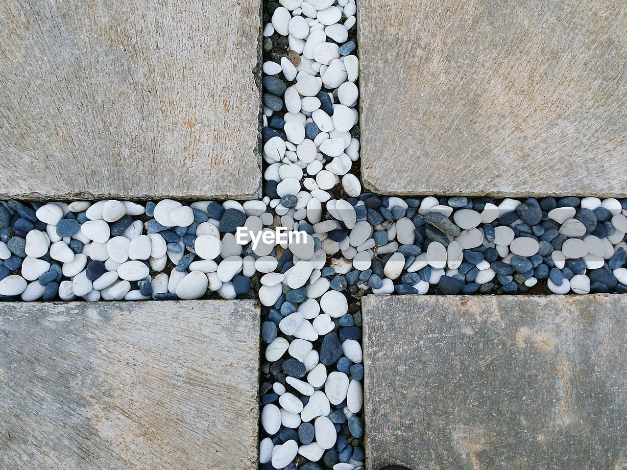 High Angle View Of Stones In Cross Shape