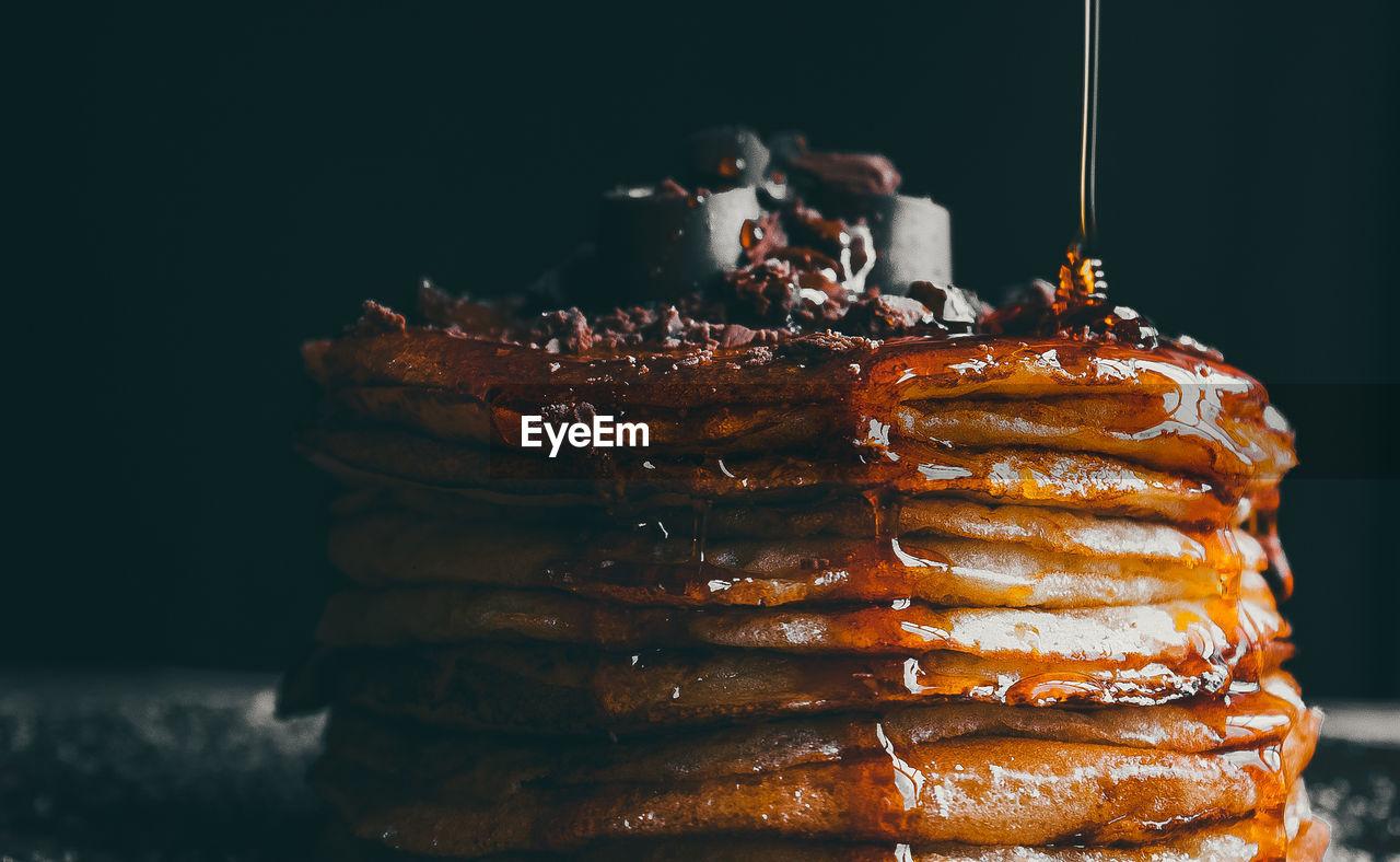 Close-Up Of Caramel Being Poured On Pancake