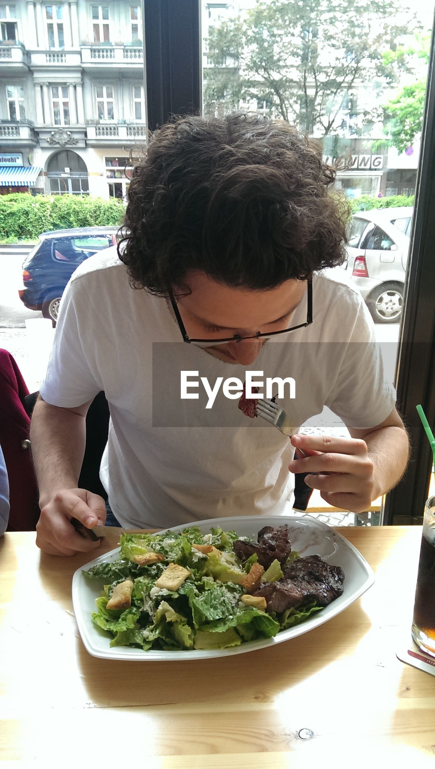 Man eating salad in restaurant