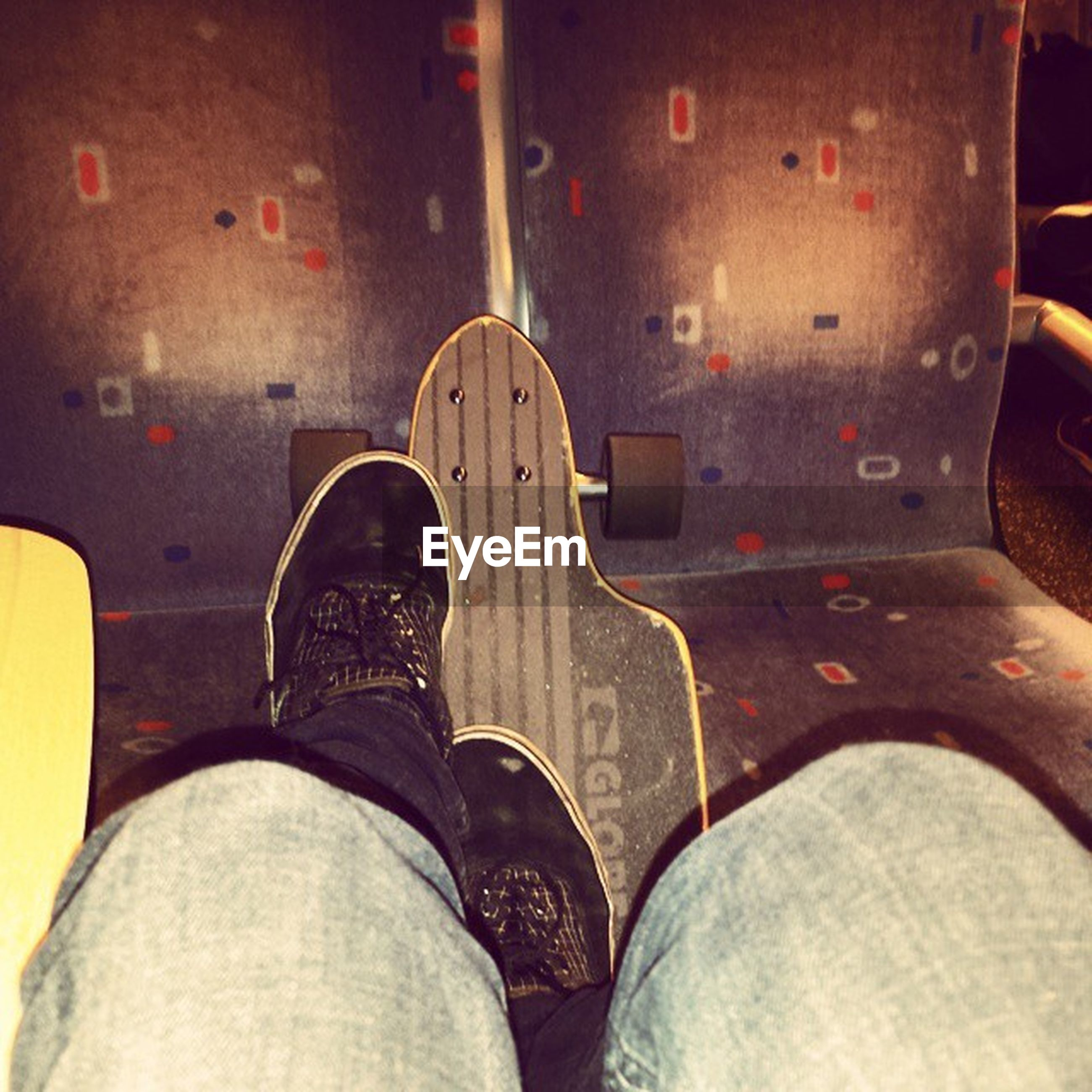 low section, shoe, person, transportation, personal perspective, mode of transport, indoors, travel, part of, footwear, men, close-up, jeans, human foot, lifestyles, vehicle interior, standing
