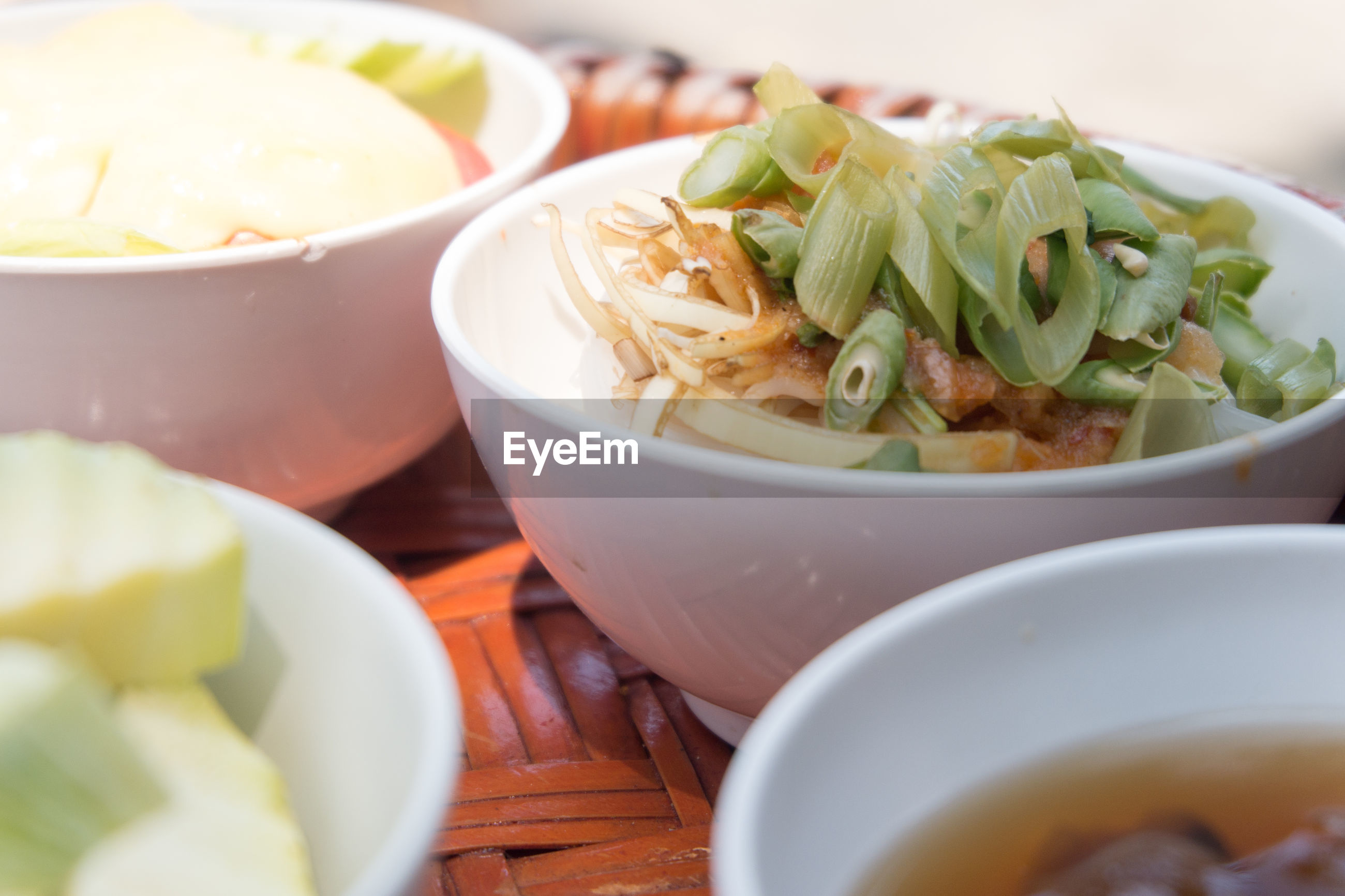 Close-up of salad and soup in bowls on table