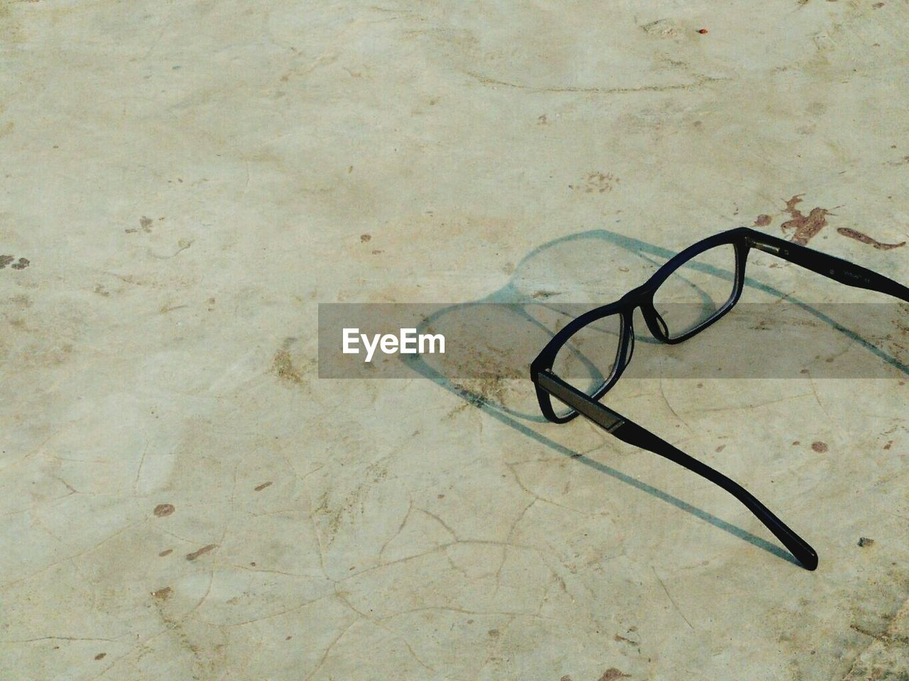 Close-Up Of Eyeglasses On Marble