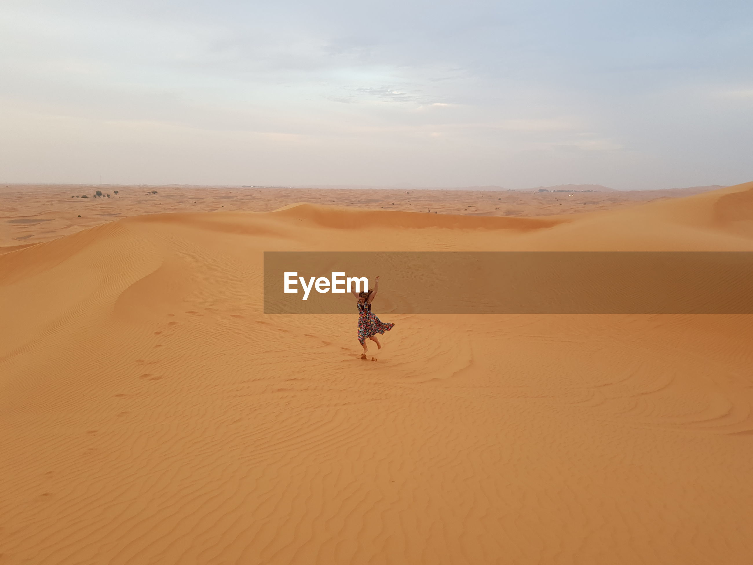 Woman jumping at desert